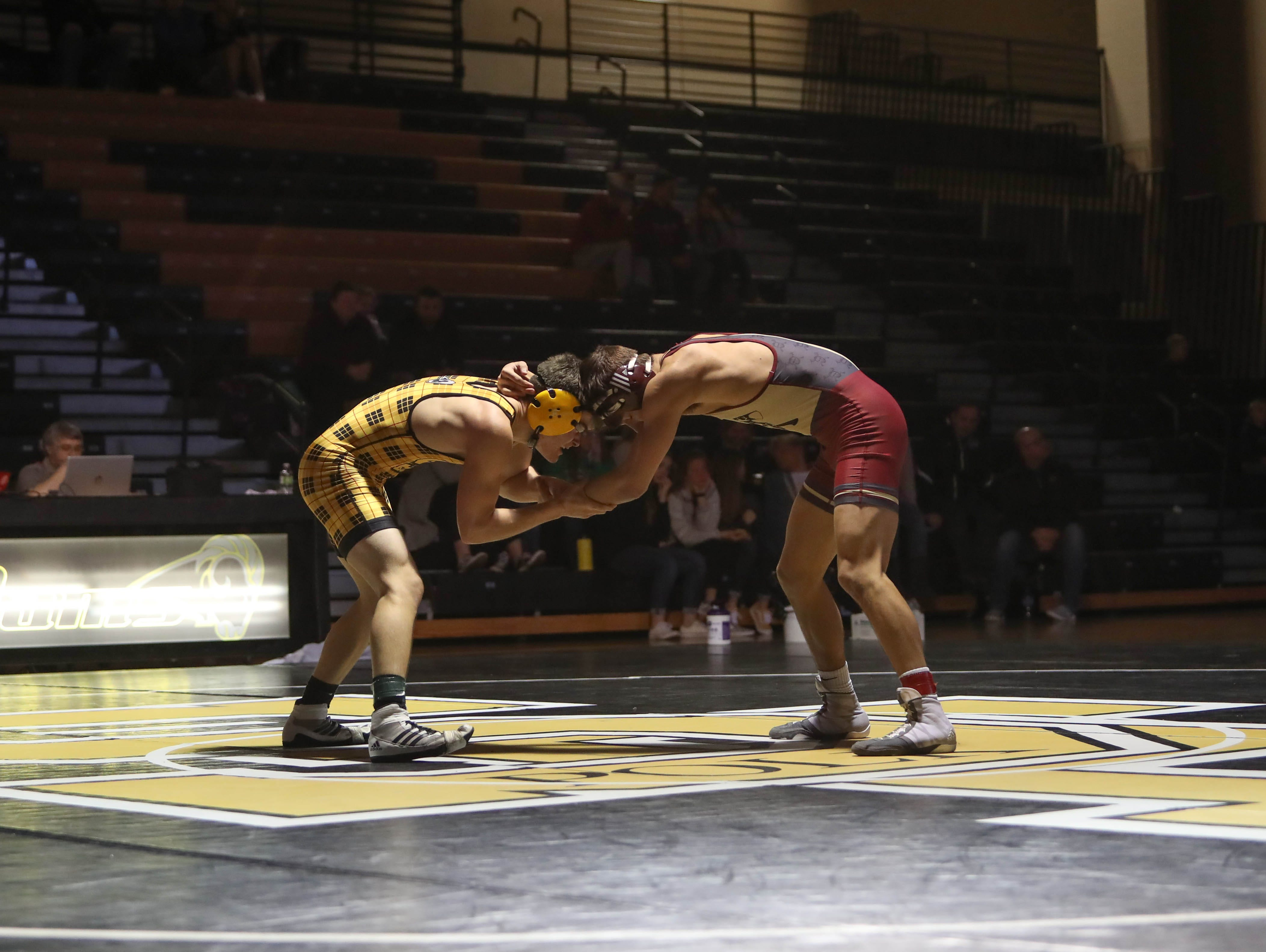 John Harris Jr., of Des Moines Lincoln, wrestles with Southeast Polk's Eli Reed. The Rams won 61-12 against Lincoln in the Jan. 31, 2019 match at Southeast Polk High.