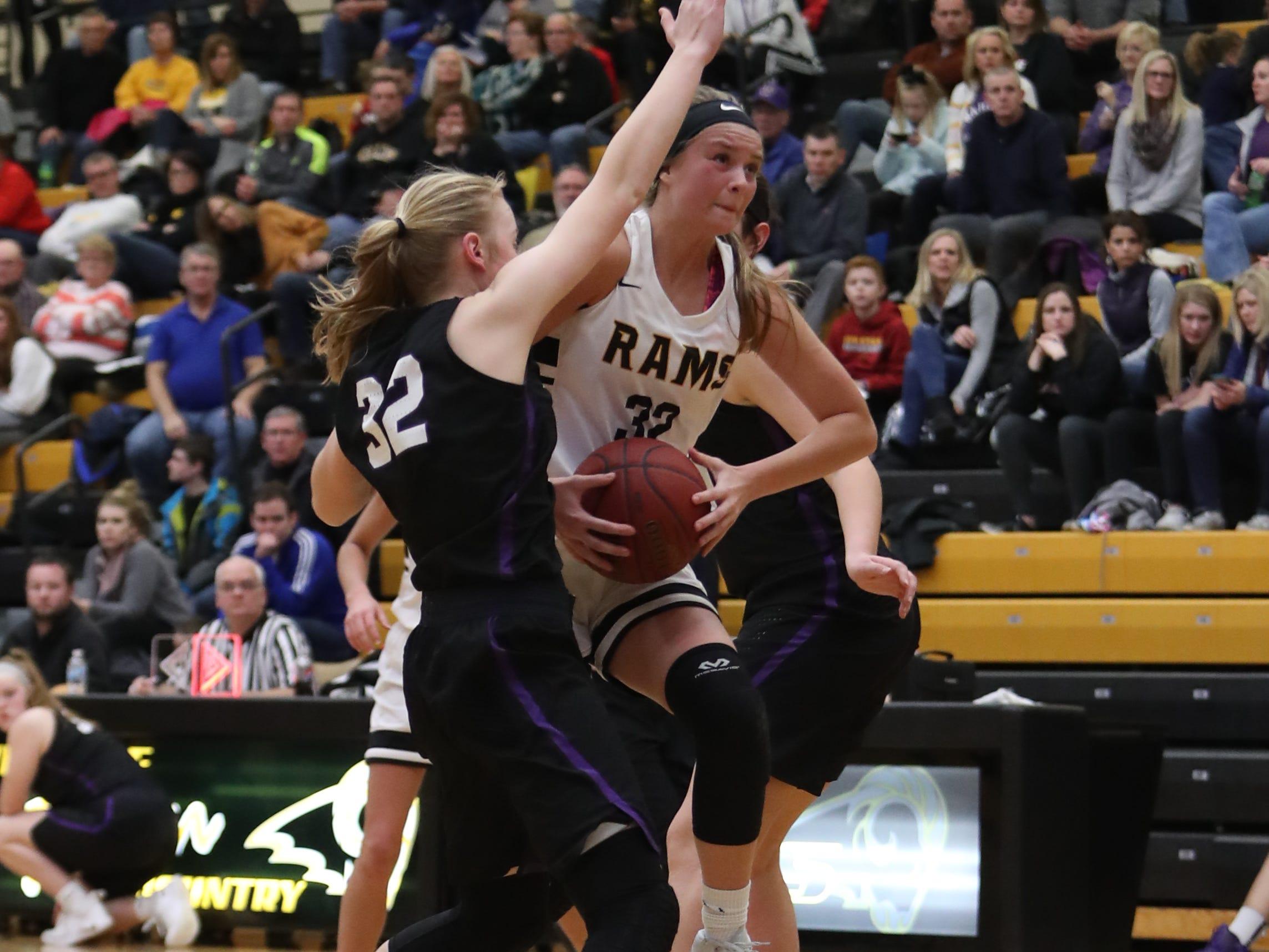 Waukee Warriors' Reagan Bartholomew (32) defends Southeast Polk Rams' Maggie McGraw (32) during a game Feb. 1, 2019 at Southeast Polk High School. The Warriors beat the Rams 66 to 43.