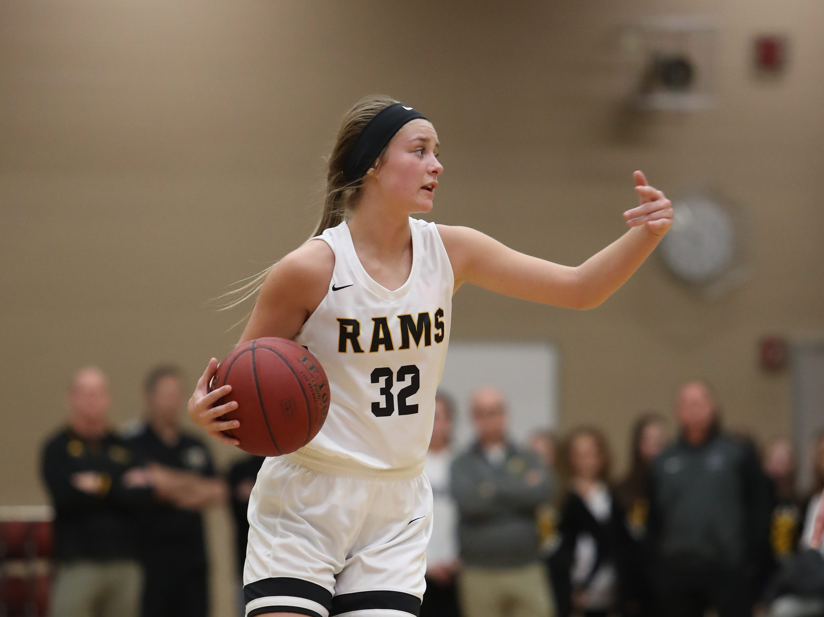 Southeast Polk Rams' Maggie McGraw (32) sets the offense against the Waukee Warriors during a game Feb. 1, 2019 at Southeast Polk High School.