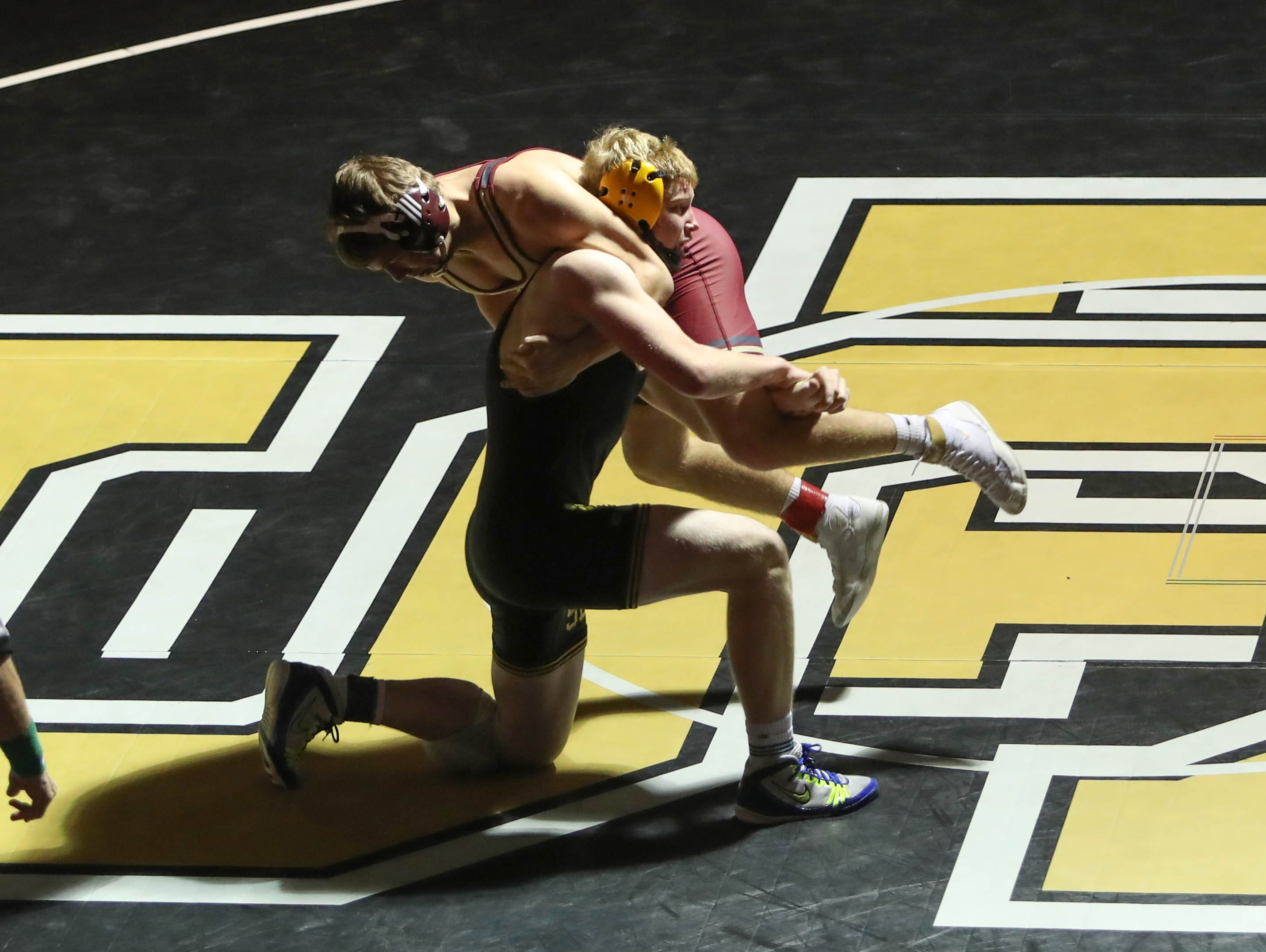 Jake Tofanelli, of Des Moines Lincoln, wrestles with Southeast Polk's Zach Strickland. The Rams won 61-12 against Lincoln in the Jan. 31, 2019 match at Southeast Polk High.