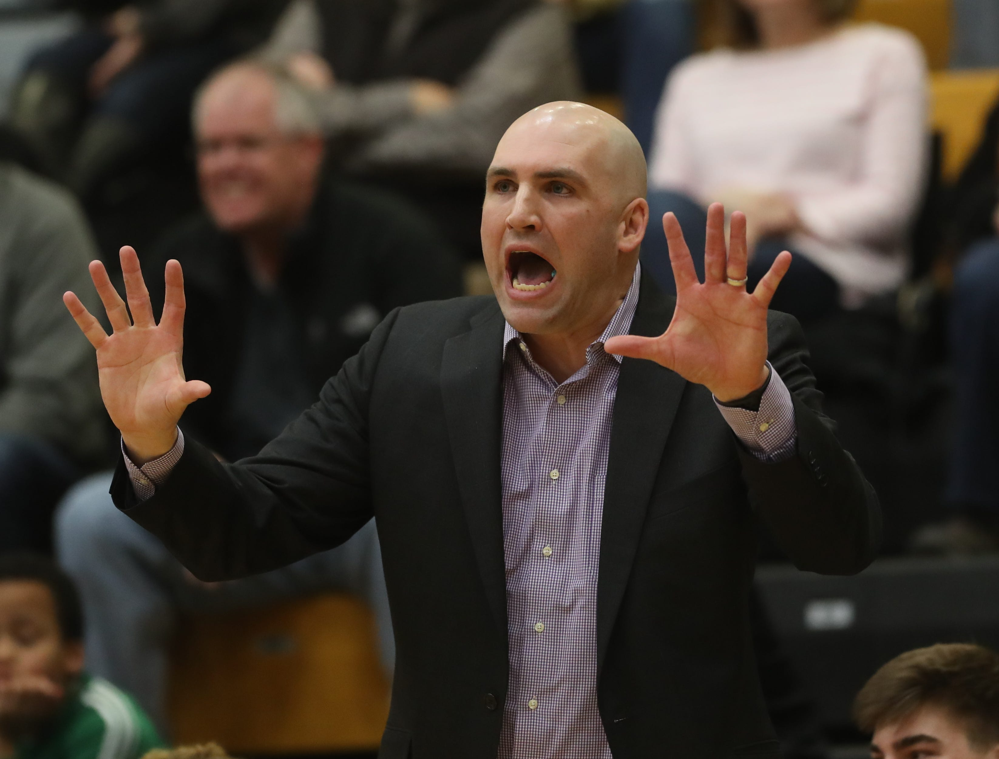 Waukee Coach Justin Ohlat watches his team during a game on Feb. 1, 2019 at Southeast Polk High School.
