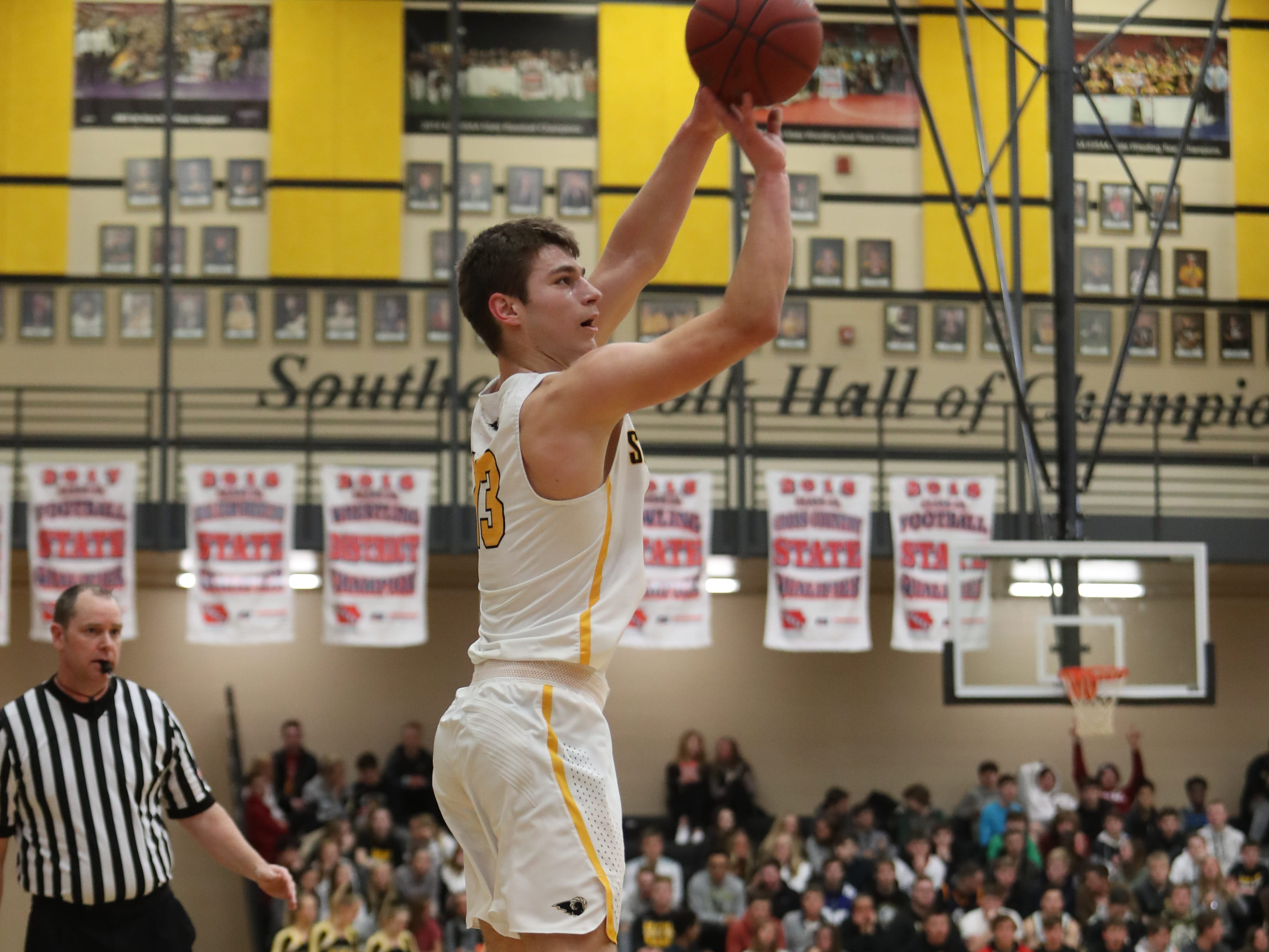 Southeast Polk Rams' Dominic Caggiano (13) shoots against the Waukee Warriors during a game on Feb. 1, 2019 at Southeast Polk High School.  the Register