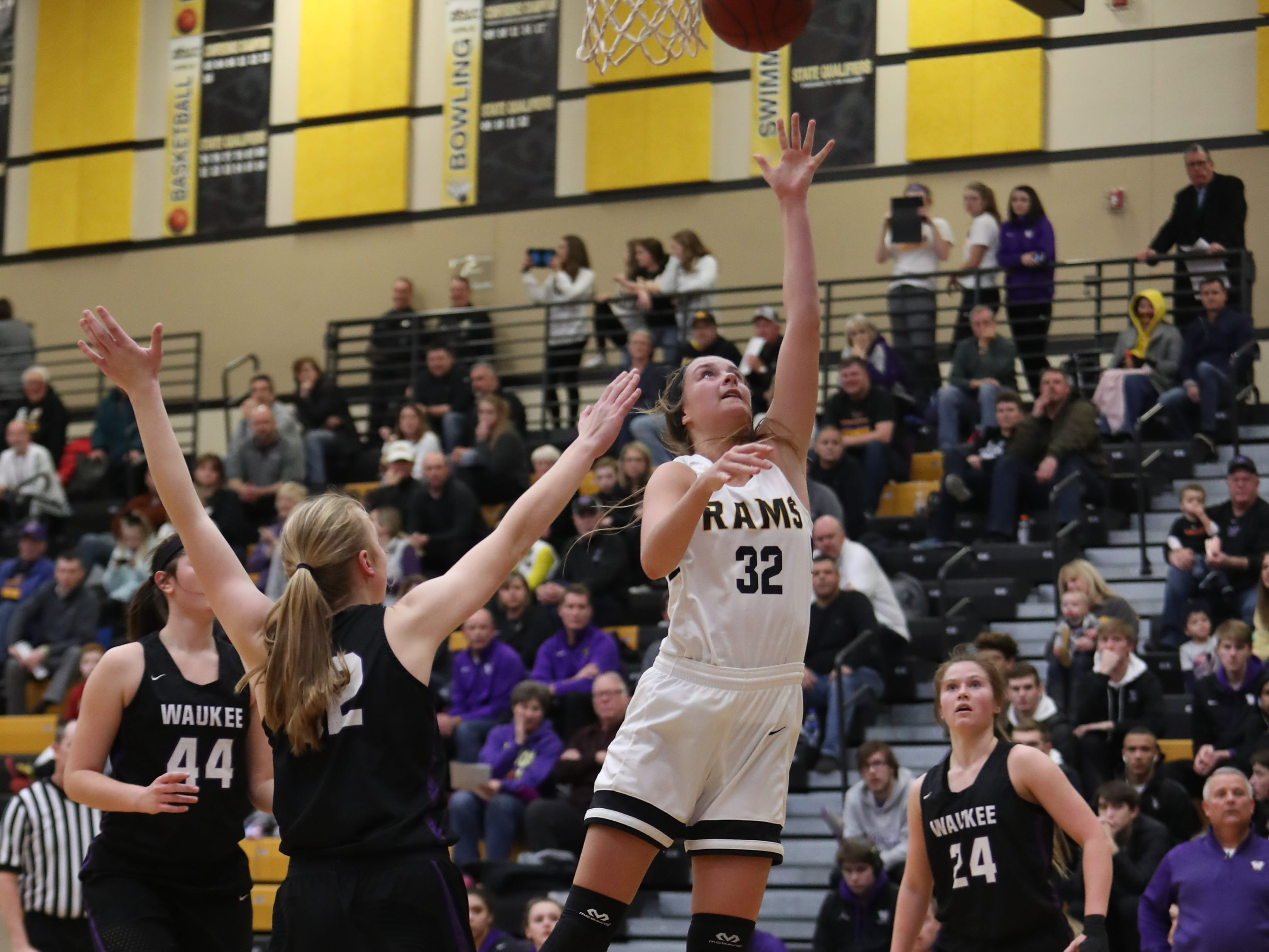 Southeast Polk Rams' Maggie McGraw (32) scores against the Waukee Warriors during a game Feb. 1, 2019 at Southeast Polk High School.