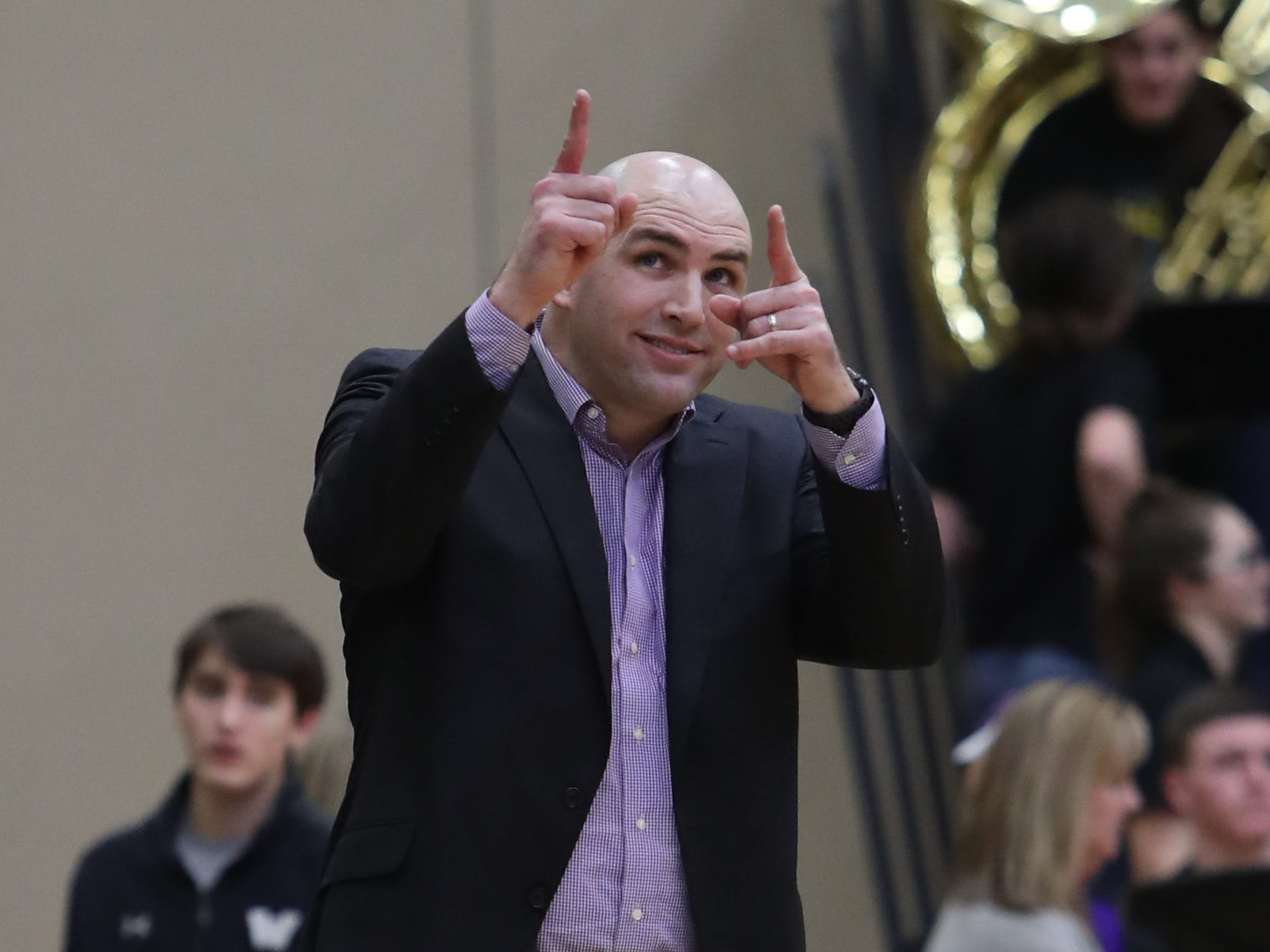 Waukee Warriors' Coach Justin Ohlat watches his team play during a game on Feb. 1, 2019 at Southeast Polk High School.