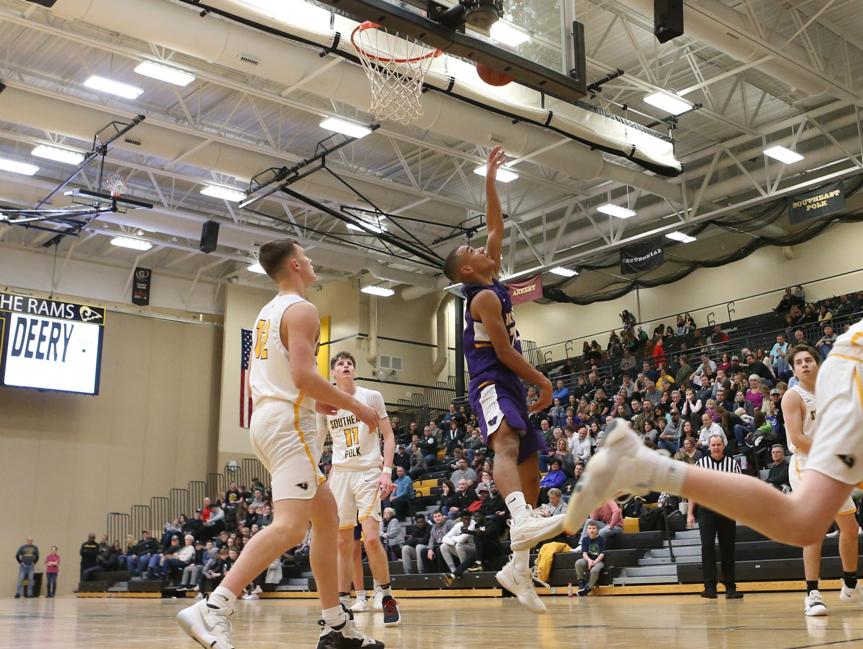Waukee Warriors' Dante Jenkins (20) scores against the Southeast Polk Rams during a game on Feb. 1, 2019 at Southeast Polk High School.