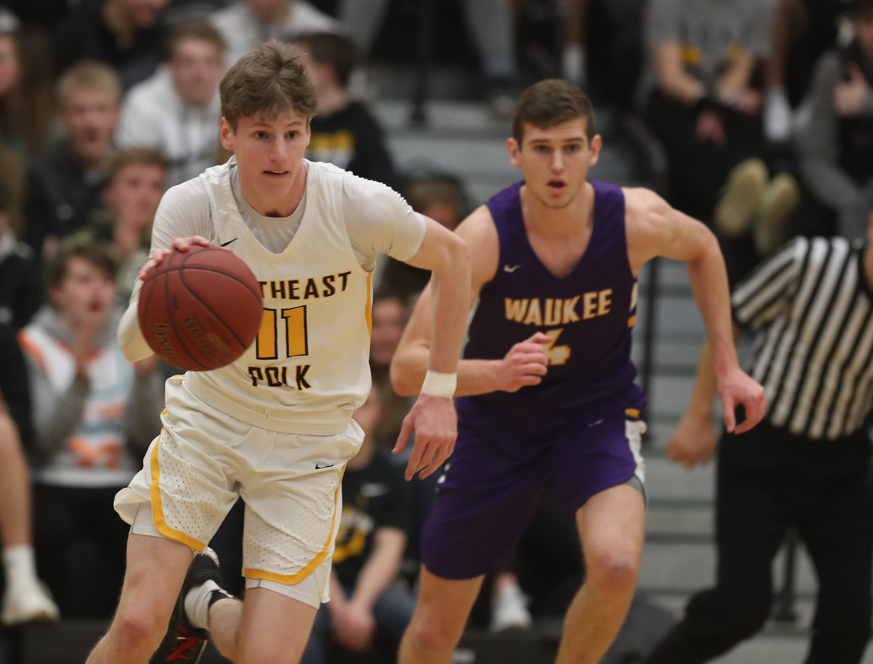 Southeast Polk Rams' Sam Glenn (11) dribbles up the court against the Waukee Warriors during a game on Feb. 1, 2019 at Southeast Polk High School. Waukee won the game 65 to 48.