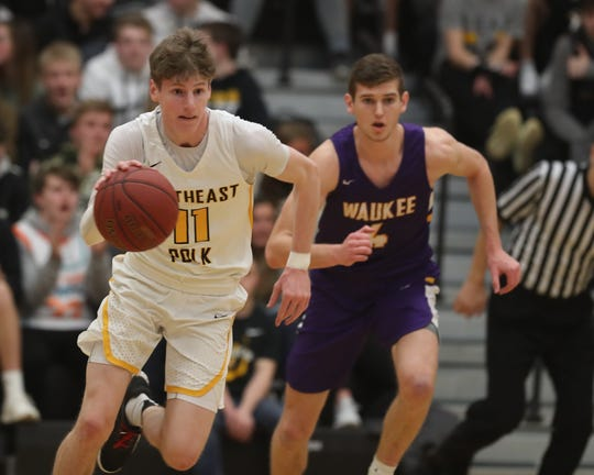 Southeast Polk's Sam Glenn (11) dribbles up the court against Waukee in a Feb. 1 game at Southeast Polk High School. Glenn had 27 points in the Rams' 52-44 loss to Dowling Catholic last week.
