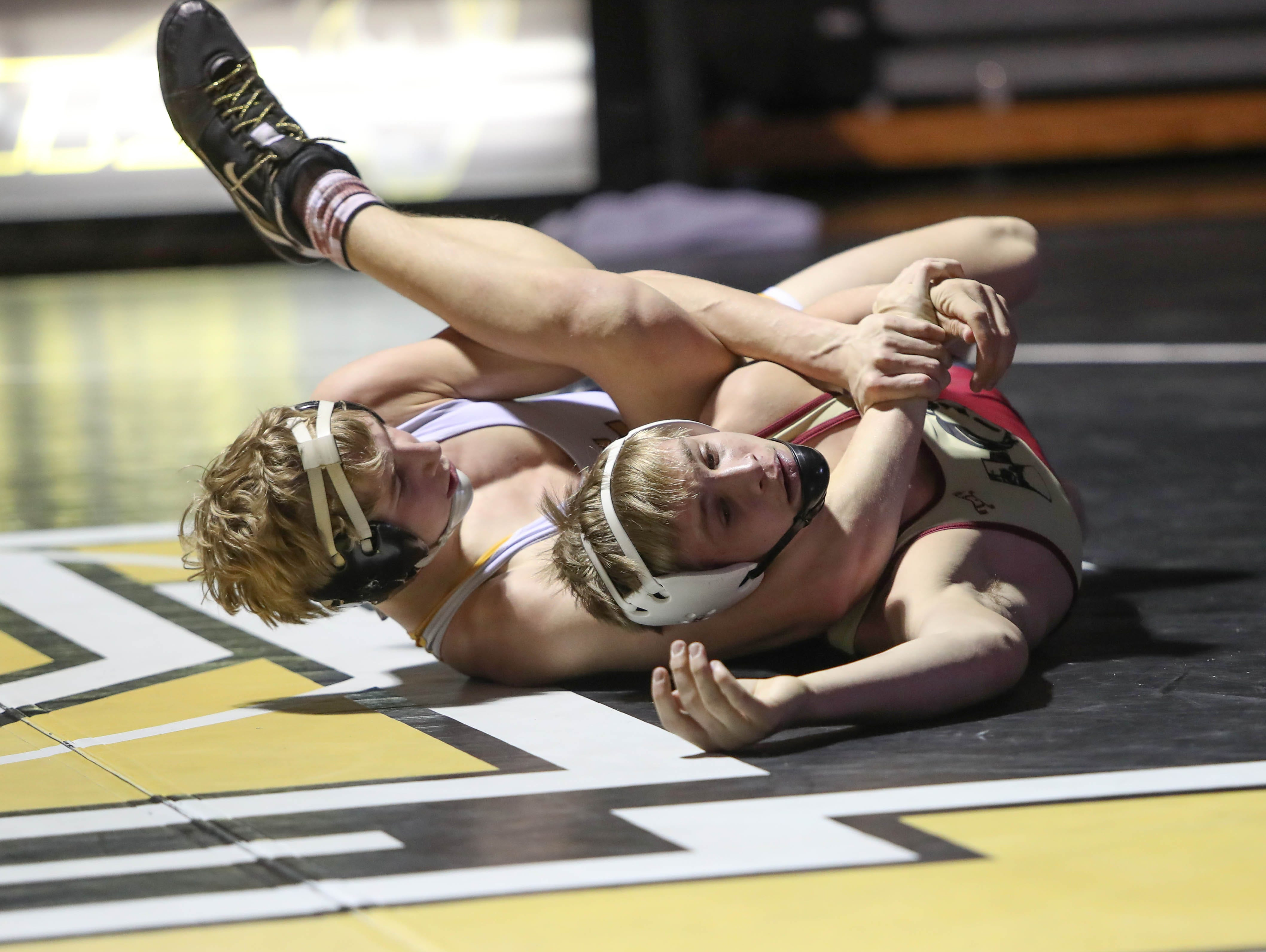 Southeast Polk's Lance Runyon wrestles with Lincoln's Mickey Griffith. The Rams won 61-12 against Lincoln in the Jan. 31, 2019 match at Southeast Polk High.