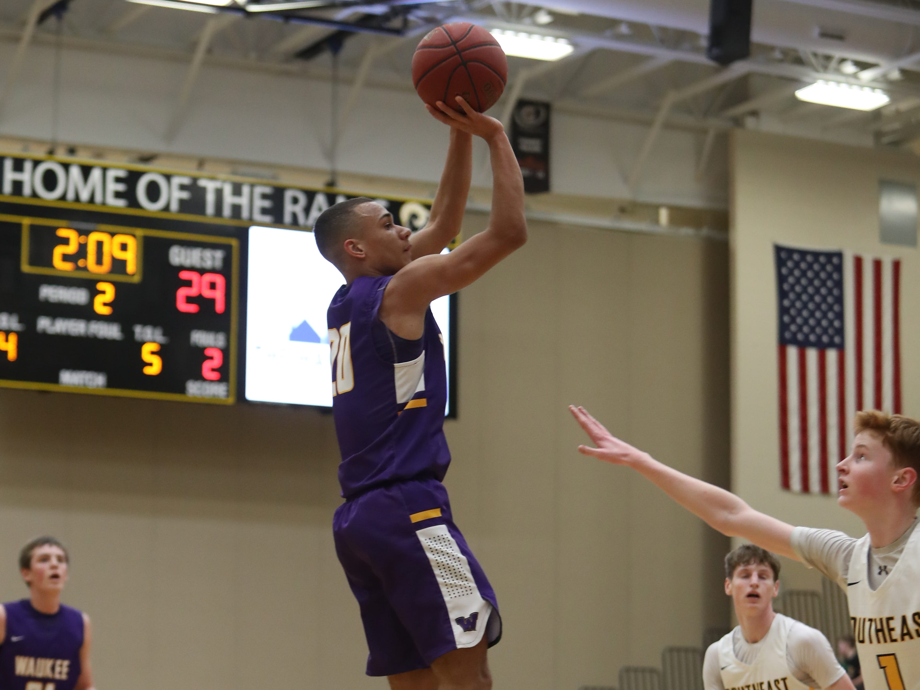 Waukee Warriors' Dante Jenkins (20) shoots against the Southeast Polk Rams during a game on Feb. 1, 2019 at Southeast Polk High School. Waukee won the game 65 to 48.
