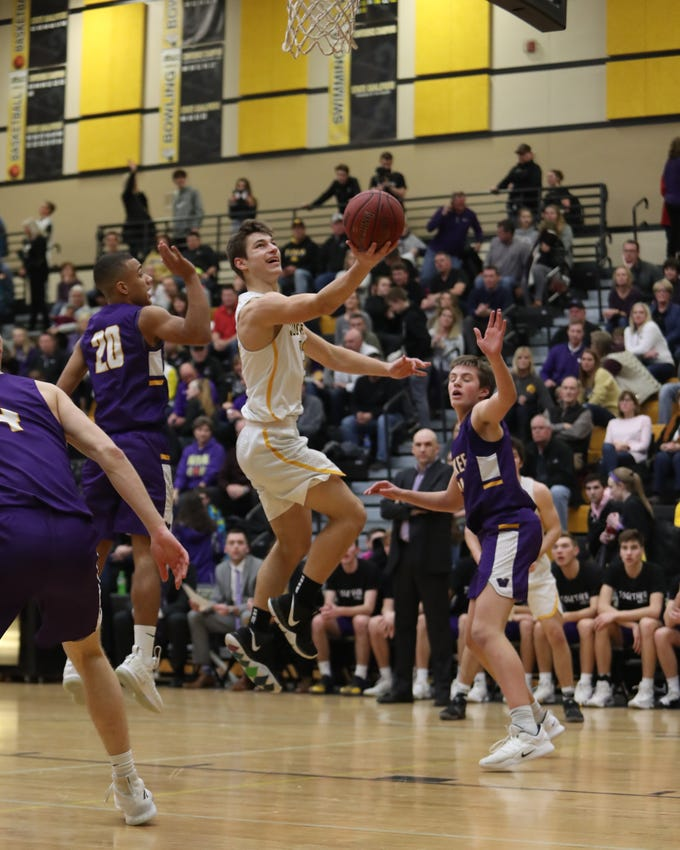 Southeast Polk Rams' Dominic Caggiano (13) splits the defense against the Waukee Warriors during a game on Feb. 1, 2019 at Southeast Polk High School. Waukee won the game 65 to 48.