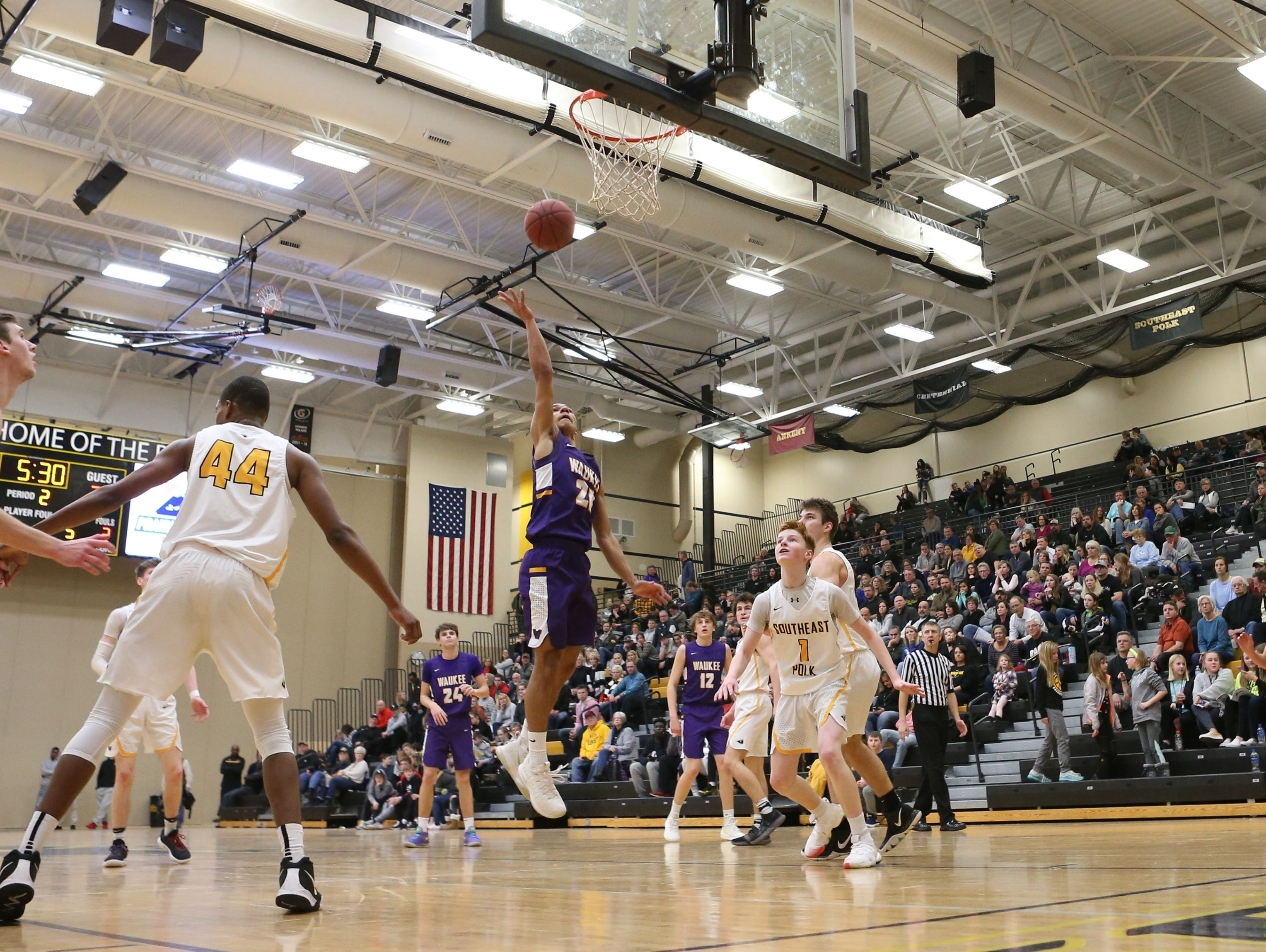 Waukee Warriors' Dante Jenkins (20) scores in the paint against the Southeast Polk Rams during a game on Feb. 1, 2019 at Southeast Polk High School. Waukee won the game 65 to 48.