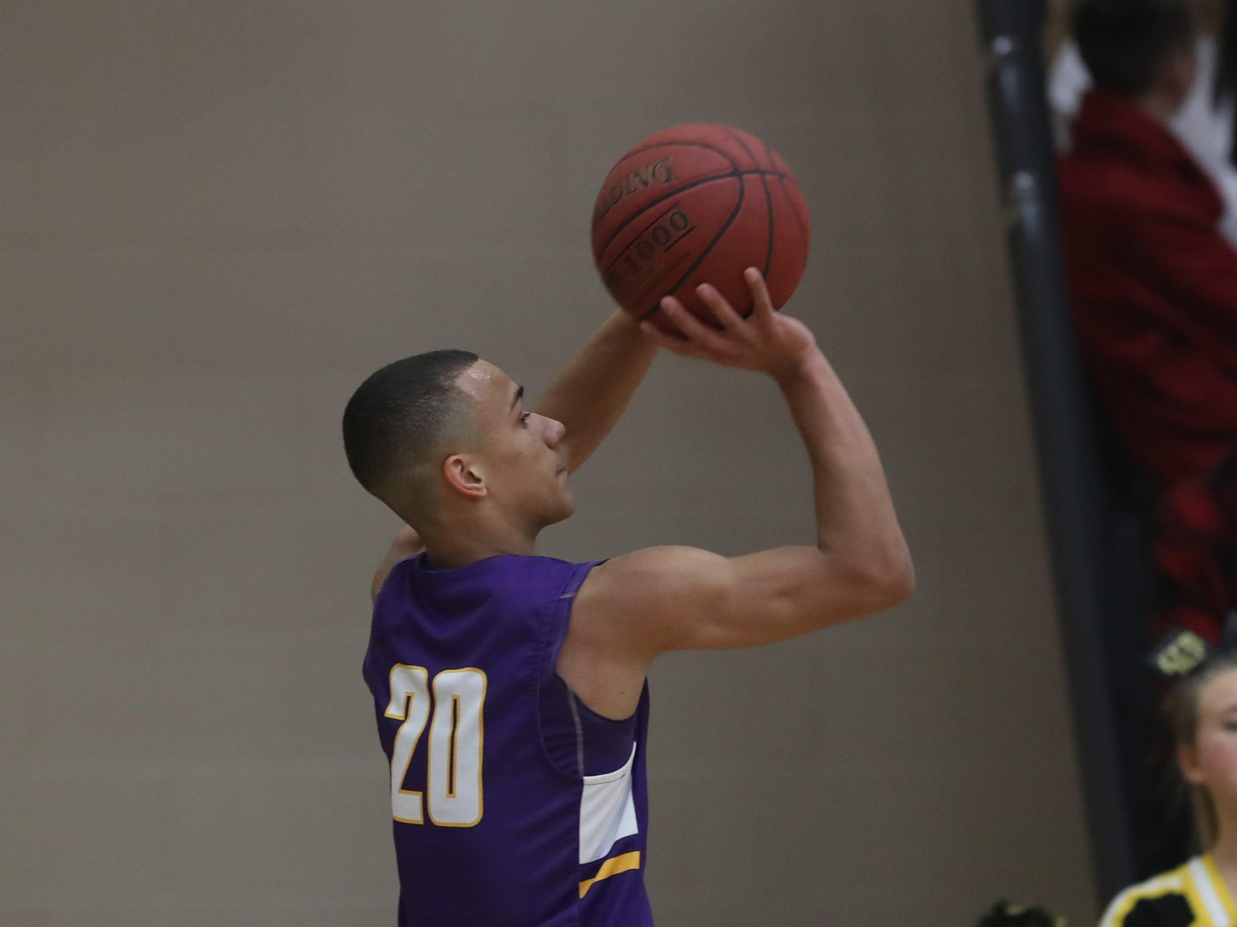 Waukee Warriors' Dante Jenkins (20) shoots against the Southeast Polk Rams during a game on Feb. 1, 2019 at Southeast Polk High School.