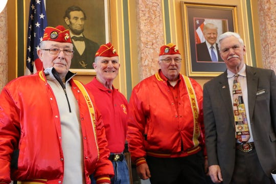 Members of the Larry Nehring Marine Corps League,  P. J. Pins of Norwalk, Dennis Jones of Des Moines and George Kline of Mitchellville meet with state Rep. Stan Gustafson at the state Capitol.