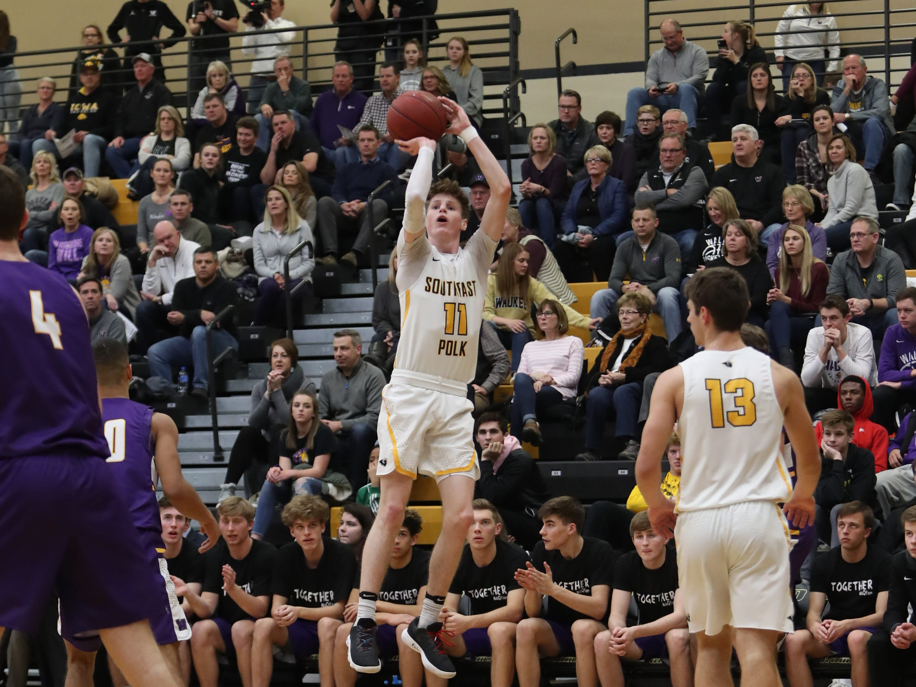 Southeast Polk Rams' Sam Glenn (11) shoots from the outside against the Waukee Warriors during a game on Feb. 1, 2019 at Southeast Polk High School.