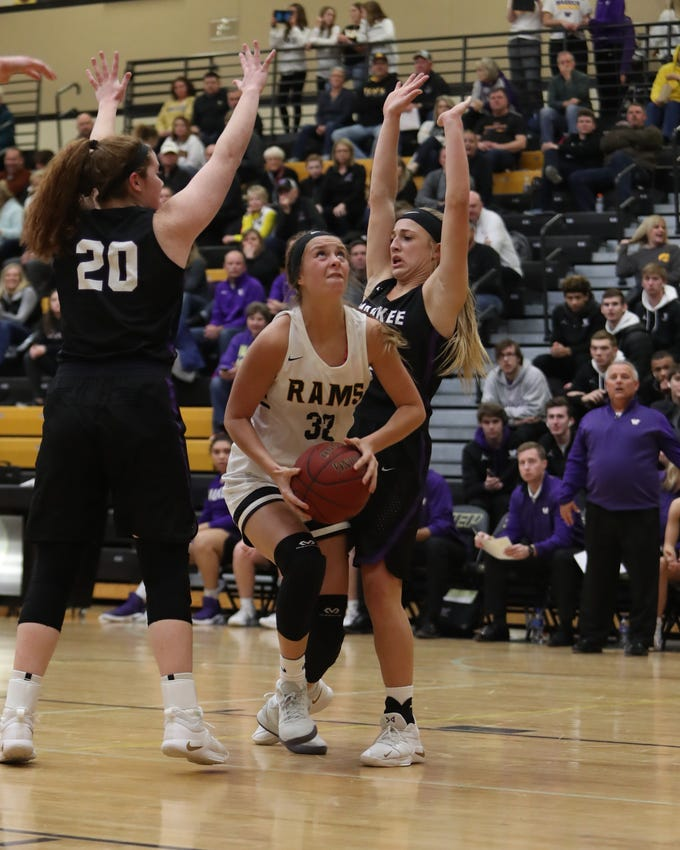 Southeast Polk Rams' Maggie McGraw (32) splits the Waukee defense during a game Feb. 1, 2019 at Southeast Polk High School. The Warriors beat the Rams 66 to 43.