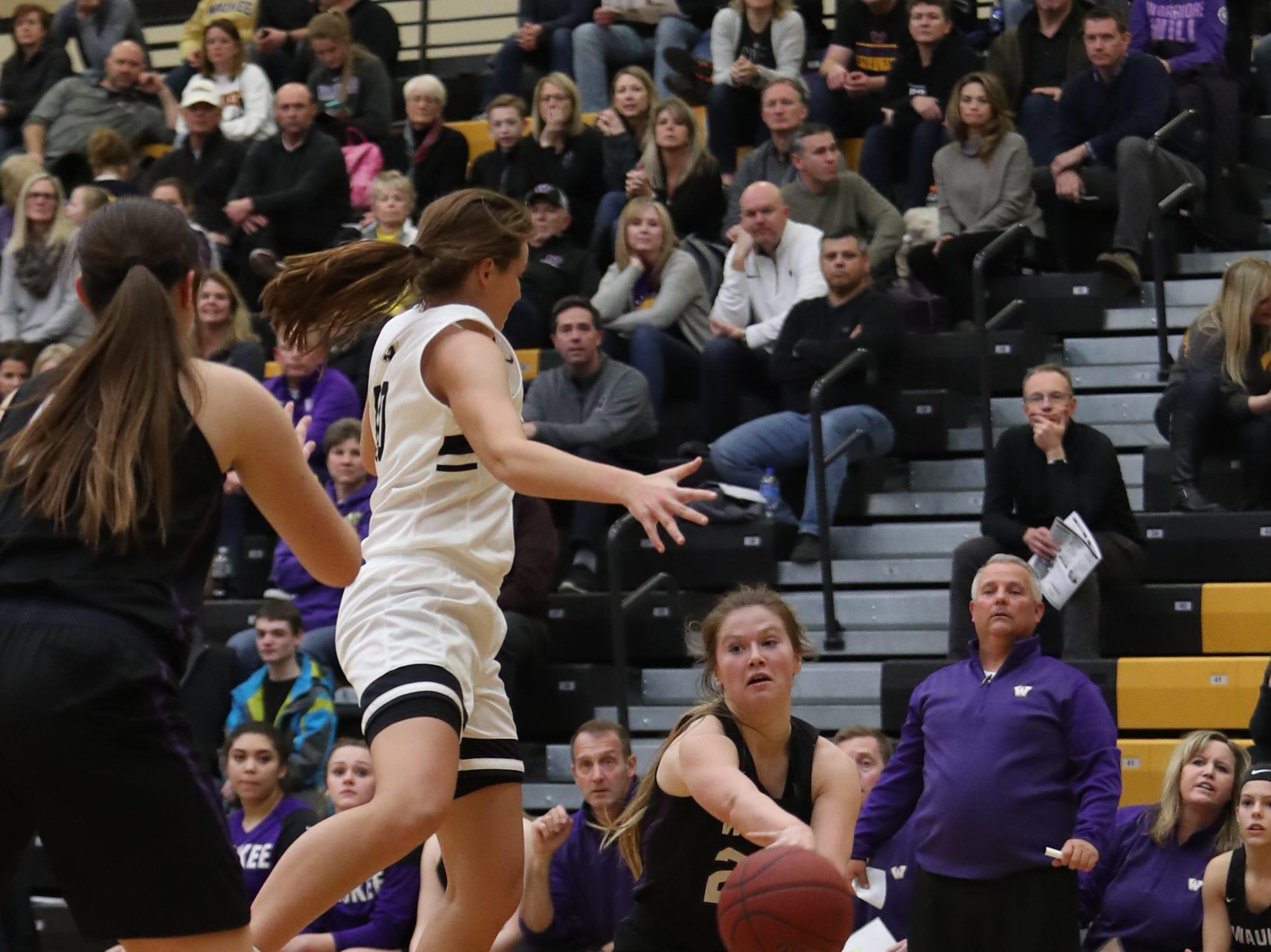 Waukee Warriors' Anna Brown (20) passes the ball during a game Feb. 1, 2019 at Southeast Polk High School.