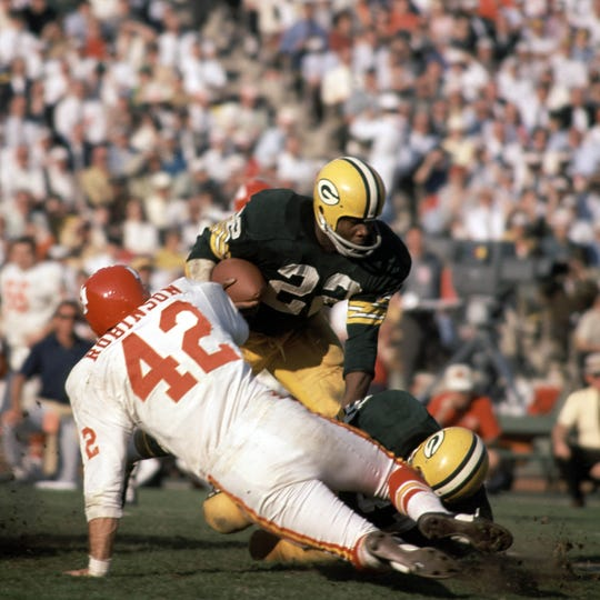 Jan 15, 1967; Los Angeles, CA, USA; FILE PHOTO; Green Bay Packers running back Elijah Pitts (22) carries the ball past Kansas City Chiefs defensive back Johnny Robinson (42) during Super Bowl I at the Los Angeles Coliseum in the first ever meeting of the AFL vs NFL World Championship.  The Packers defeated the Chiefs 35-10.