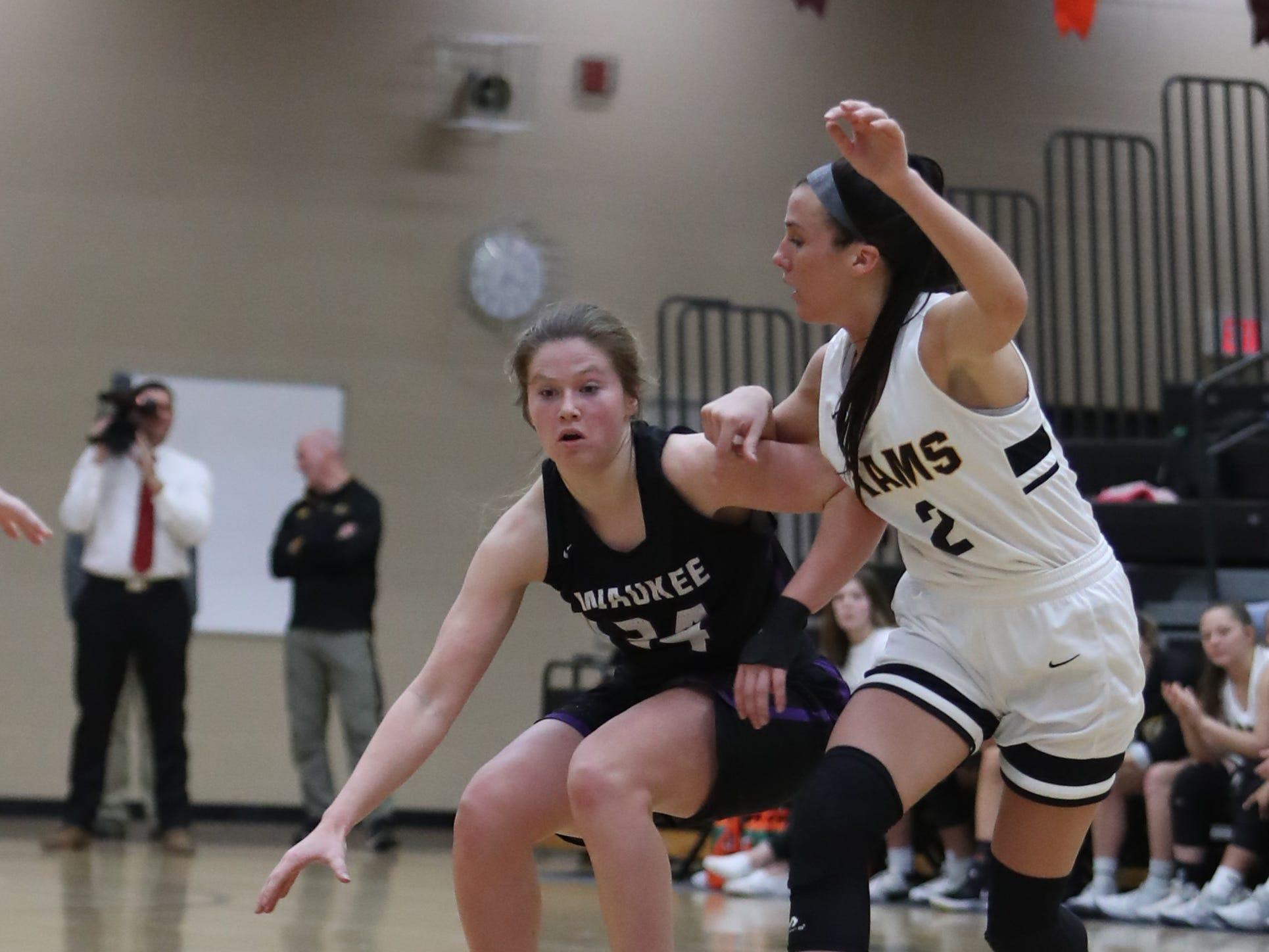Southeast Polk Rams' Liza Sutten (2) defends Waukee Warriors' Jori Nieman (24) during a game Feb. 1, 2019 at Southeast Polk High School.