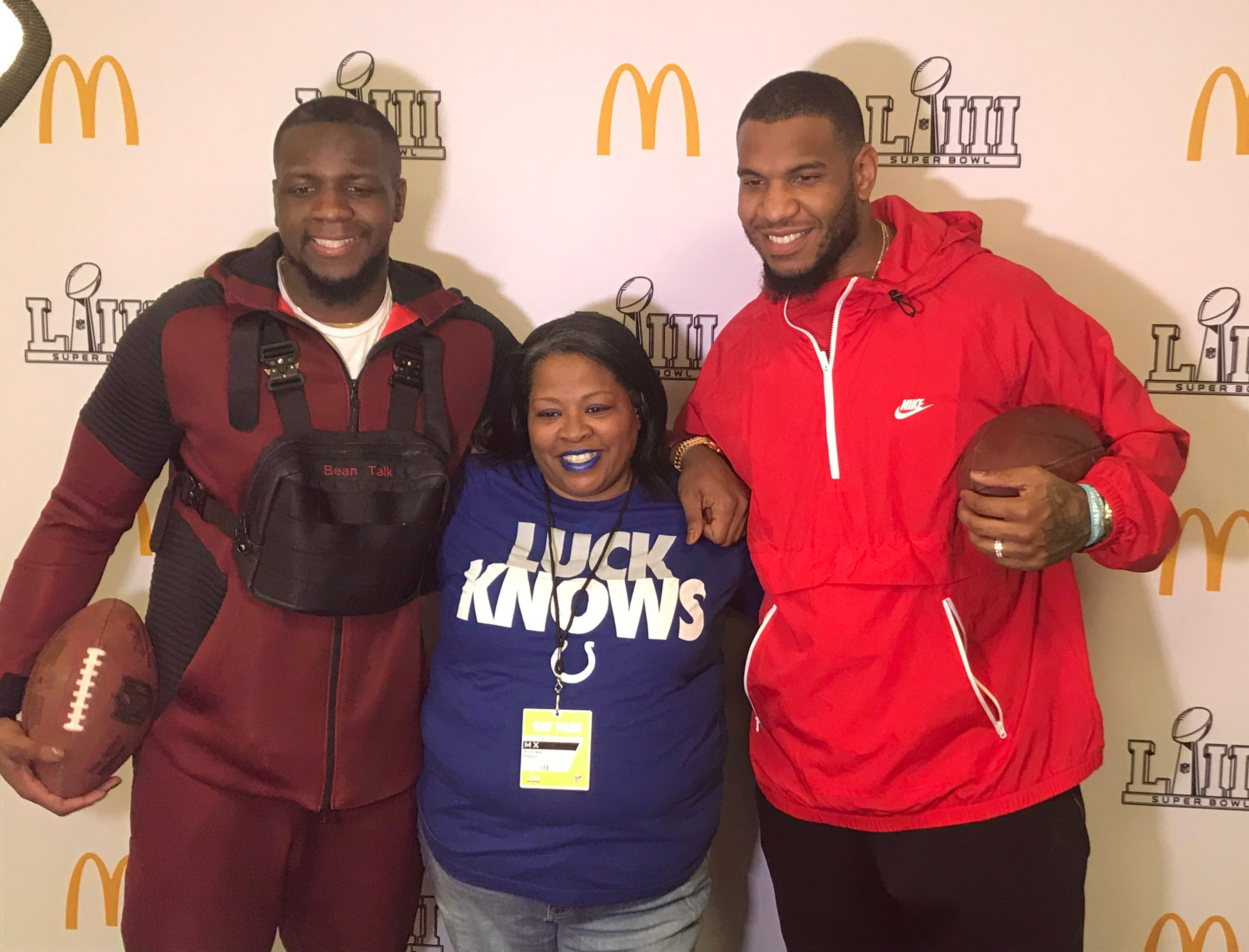 Atlanta Falcons wide receiver Mohamed Sanu, left, and Indianapolis Colts tight end Eric Ebron, right, pose with a fan at the NFL Play Family Football Challenge in Atlanta on Saturday, Feb. 2, 2019.