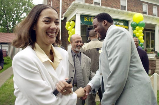 Christine Beatty, left, and then future mayor Kwame Kilpatrick touch hands after Kilpatrick's May 17, 2001, announcement that he would run for mayor of Detroit. Kilpatrick announced his candidacy in front of the Detroit home of his mother, Congress member Carolyn Cheeks Kilpatrick.