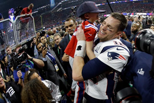 Tom Brady lifts his son, Ben, after winning Super Bowl LIII against the Rams on Sunday.