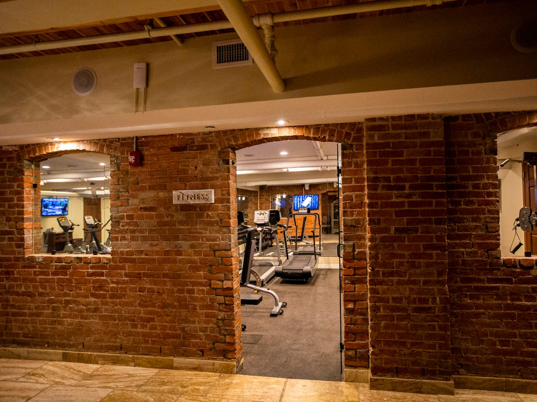Exposed brick surrounds the fitness club at the Soak Spa at the Detroit Club in downtown Detroit on Friday, Feb. 1, 2019.