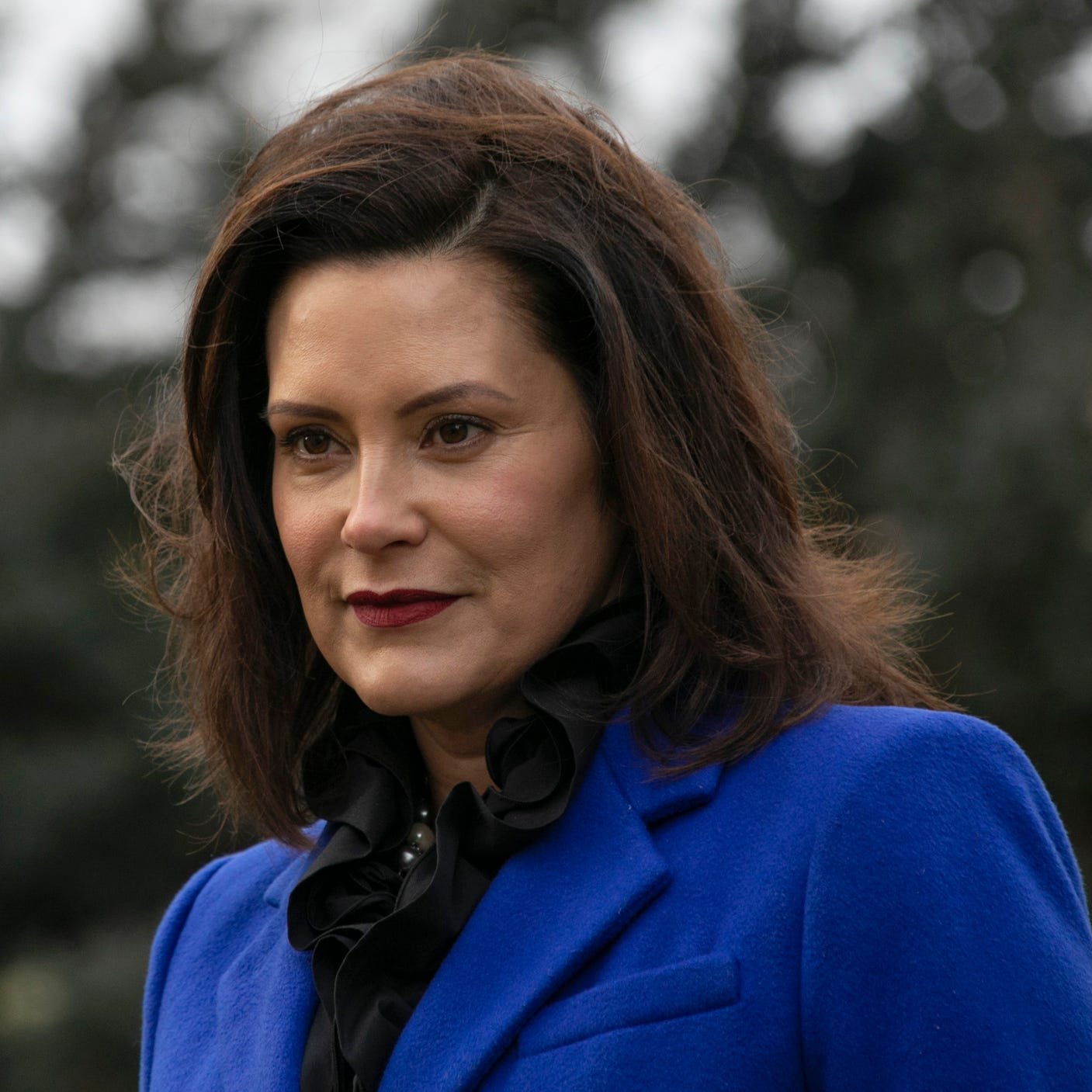 Michigan Governor Gretchen Whitmer, stands in front of the Michigan State Capitol building in Lansing in December, 2018.