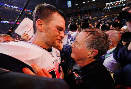 Tom Brady celebrates with coach Bill Belichick after defeating the Rams.
