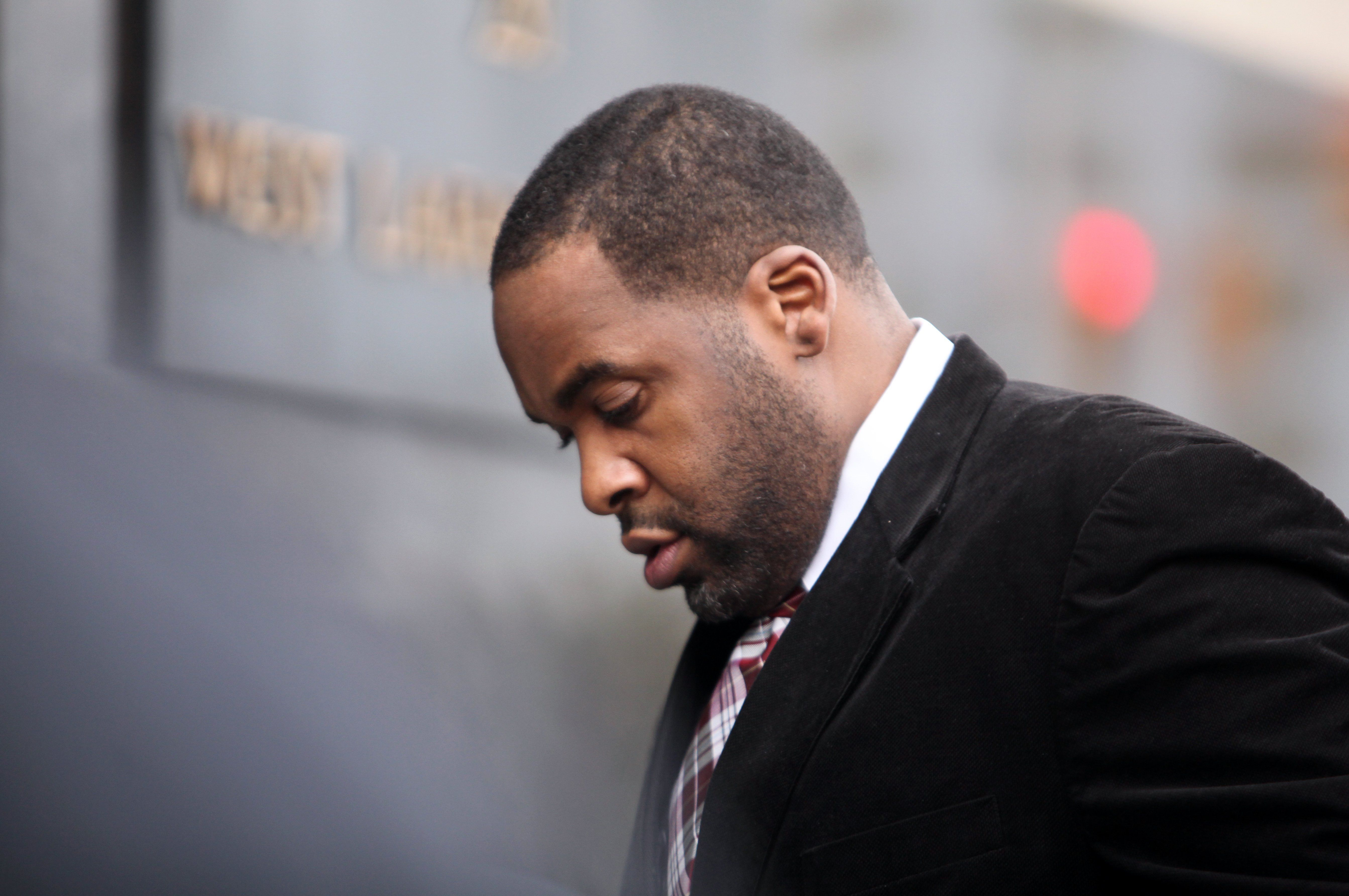 Former Detroit mayor Kwame Kilpatrick makes his way in to federal court in Detroit on Monday, March 11, 2013. The jury has reached a verdict in the public corruption trial.