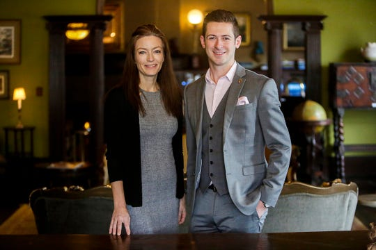 Membership Director Lena Angott and Director of Operations Matthew Peterson stand in the sitting room at the Detroit Club in downtown Detroit on Friday, Feb. 1, 2019.