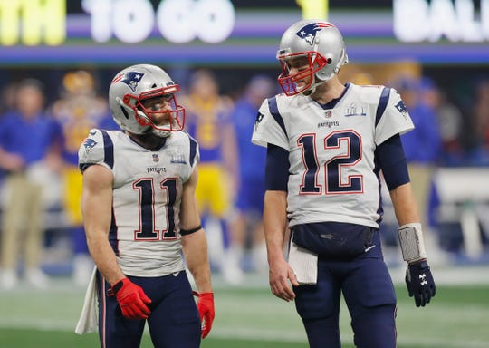 Julian Edelman, left, and Tom Brady talk during the fourth quarter.