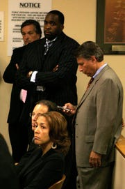 Mayor Kwame Kilpatrick and former Chief of Staff Christine Beatty listen to their lawyers talk with Judge Ronald Giles in 36th District court in downtown Detroit on Frday July 25, 2008.