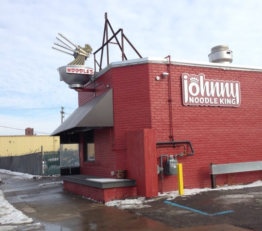 Johnny Noodle King is at 2601 W. Fort Street in Detroit in the shadow of the Ambassador Bridge and St. Anne's Cathollc Church. Mary Schroeder/Detroit Free Press
