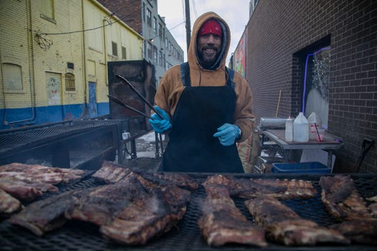 Tony Gilbert, of Hamtramck and Bert's Entertainment Complex grillman, takes on some ribs in Eastern Market Saturday, Jan. 26, 2019.