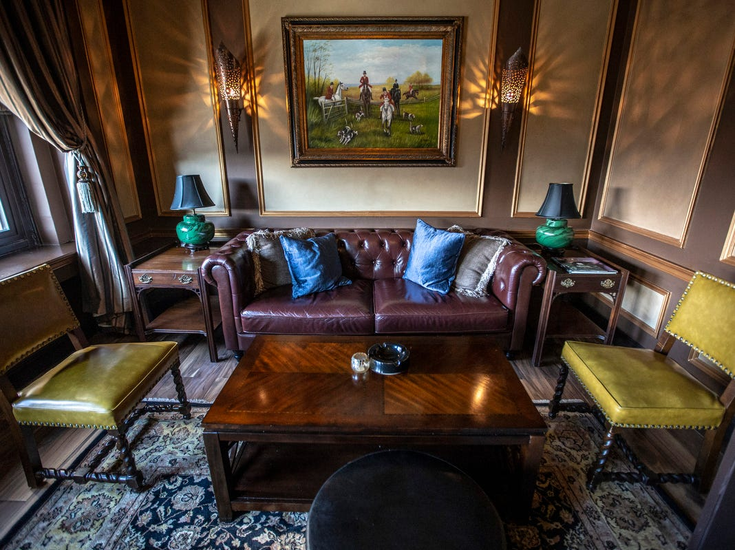 A woman's overnight room was converted to a private seating area in the Uralli cigar bar at the Detroit Club in downtown Detroit on Friday, Feb. 1, 2019.