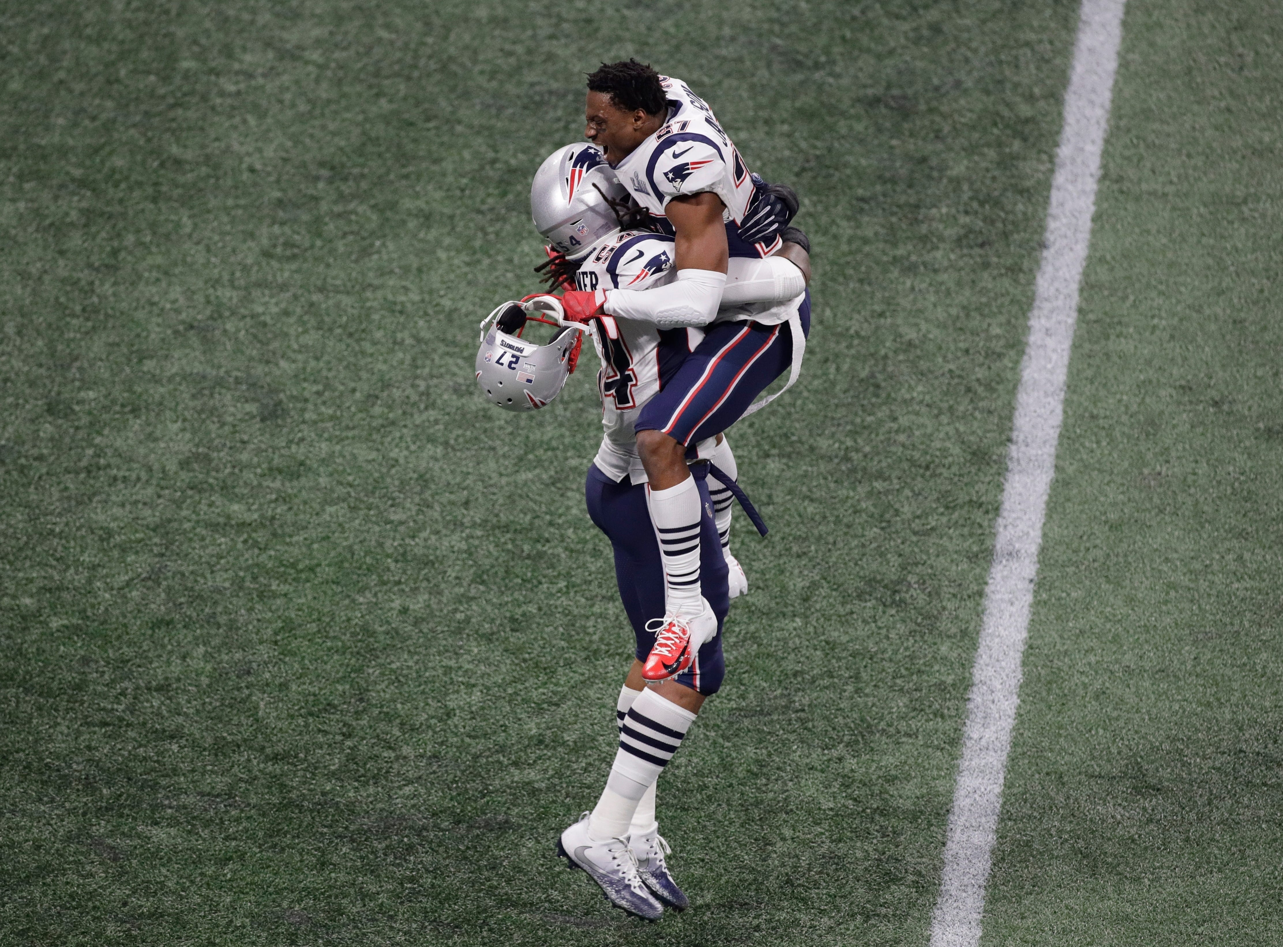 New England Patriots' J.C. Jackson (27) and New England Patriots' Dont'a Hightower (54) celebrate after the game.