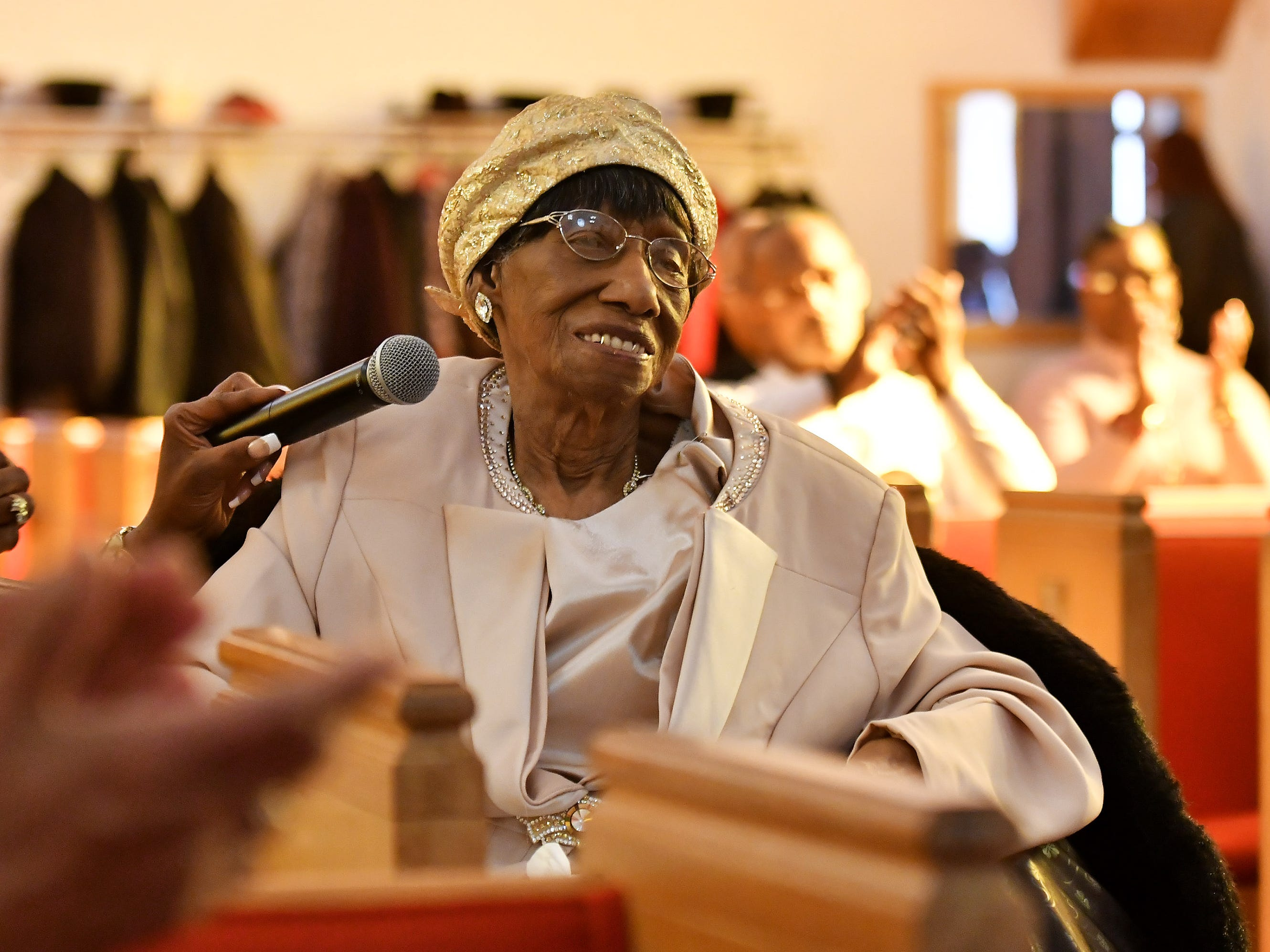 """People applaud while """"Mother"""" Lois Holden, 109, speaks at Mount Calvary Baptist Church."""