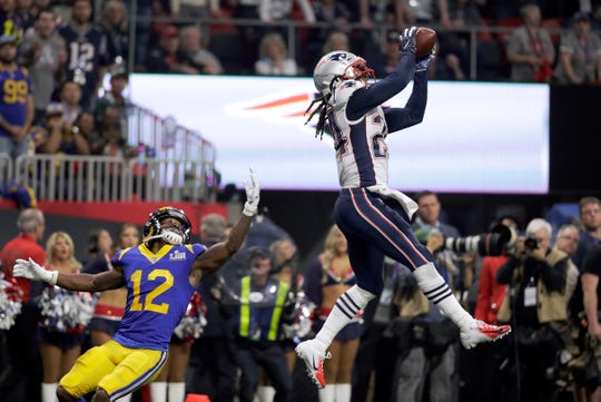 New England's Stephon Gilmore intercepts a pass intended for Los Angeles' Brandin Cooks during the second half.