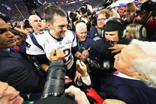 Patriots quarterback Tom Brady celebrates with owner Robert Kraft after winning Super Bowl LIII.