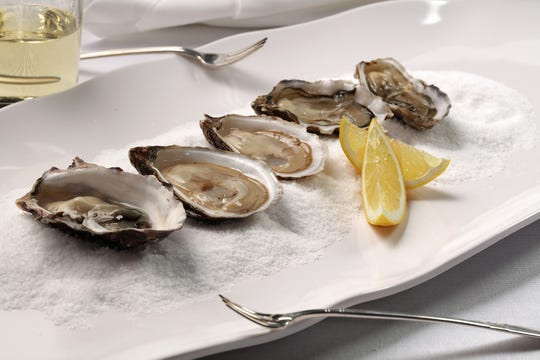 Oysters make the simplest starter for a seafood feast — just shuck and eat. A bottle of bubbly is all you need. (E. Jason Wambsgans/Chicago Tribune/TNS)
