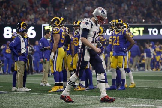 Patriots quarterback Tom Brady walks off the field during the second half.