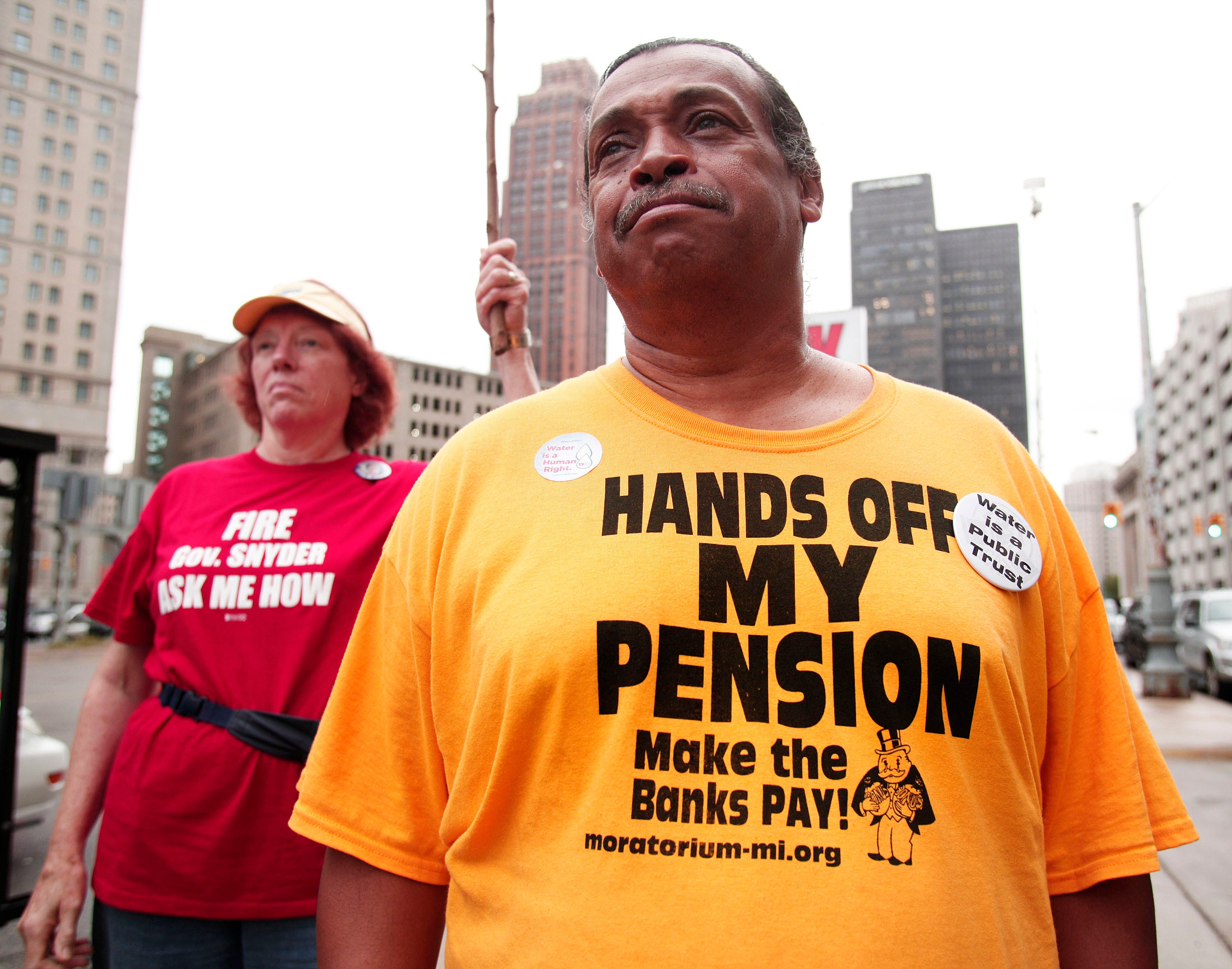 William Davis of Detroit, Michigan, a City of Detroit retiree who worked for the city's water treatment plant for 24 years, protests at the start of the City of Detroit's historic bankruptcy trial at th Federal Courthouse September 2, 2014 in Detroit, Michigan.