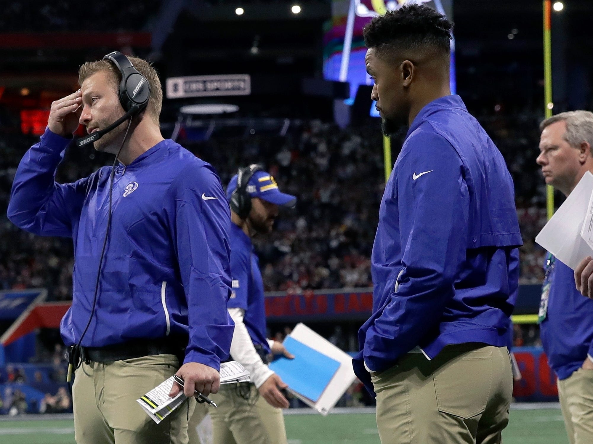 Los Angeles Rams head coach Sean McVay, left, watches from the sideline during the first half.
