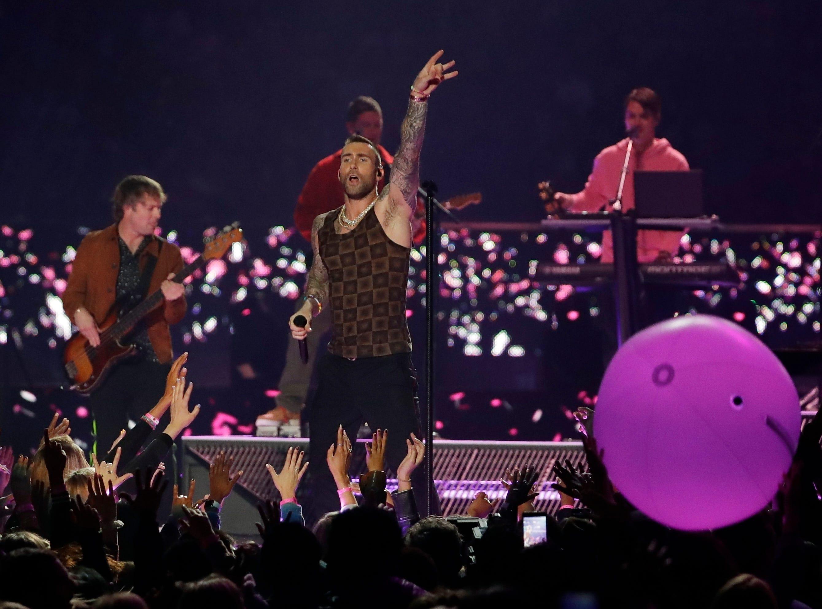 Adam Levine of Maroon 5 performs during halftime.