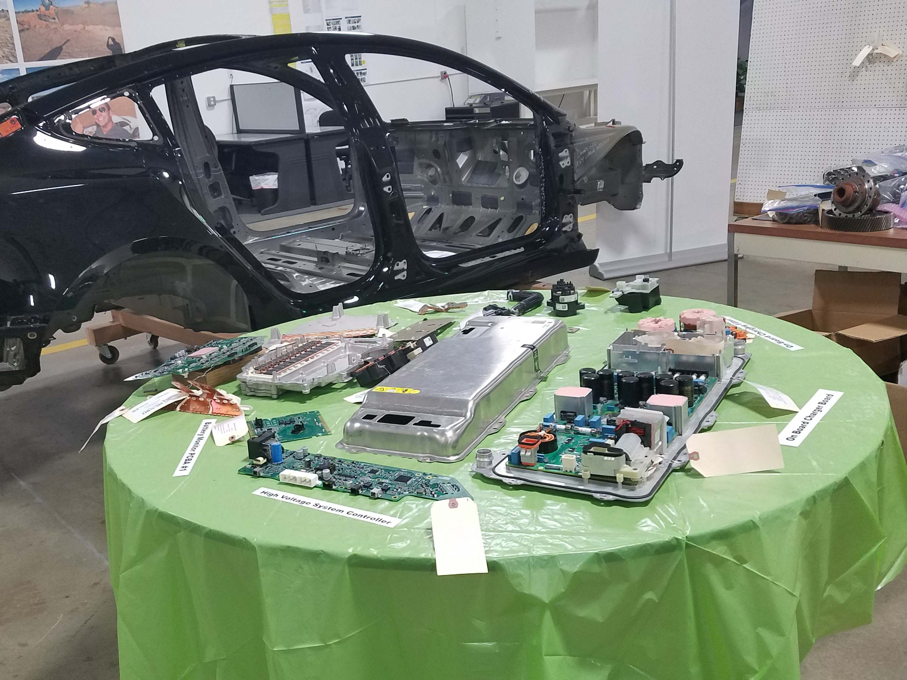 Munro & Assoc. of Auburn Hills dis-assembled a Tesla Model 3 and found its electronic systems (foreground) to be the most-advanced in the auto industry.