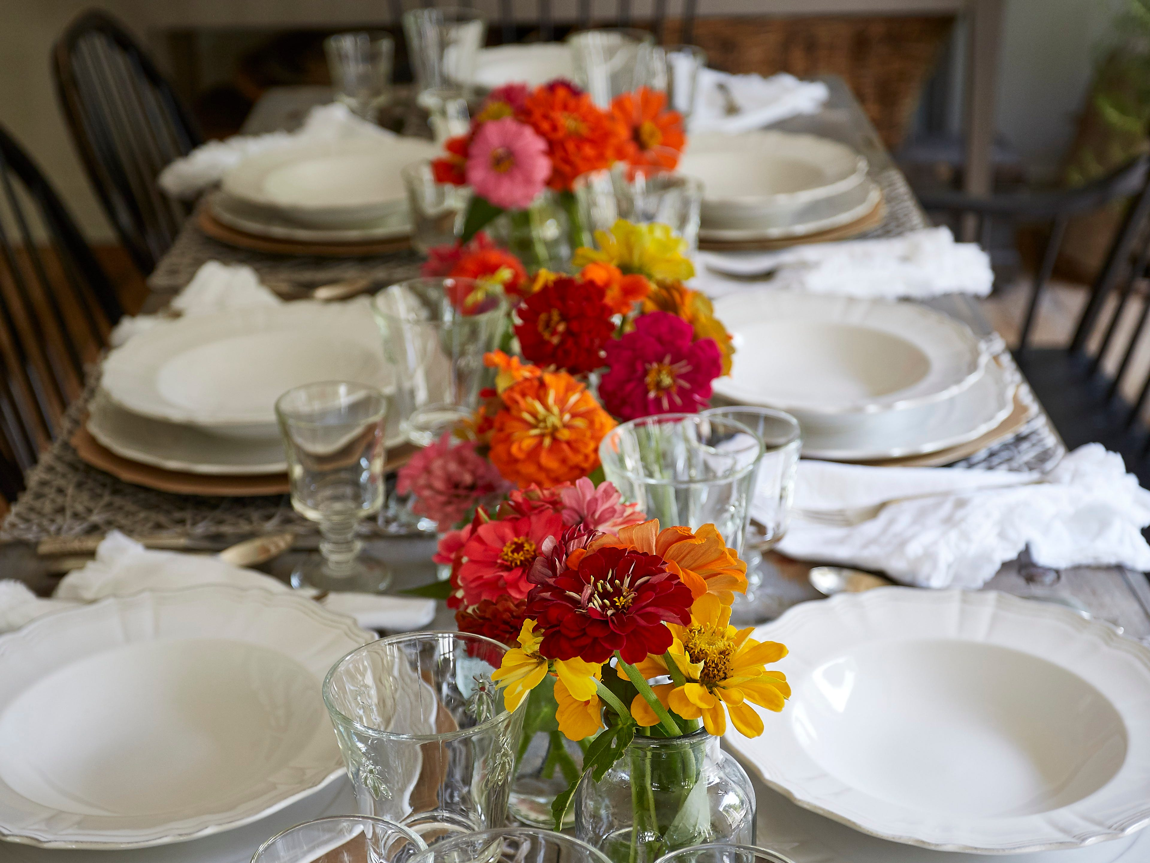 Changing the linen and flatware, adding chargers and placemats and swapping fauna for flora can give the same table a very different look.
