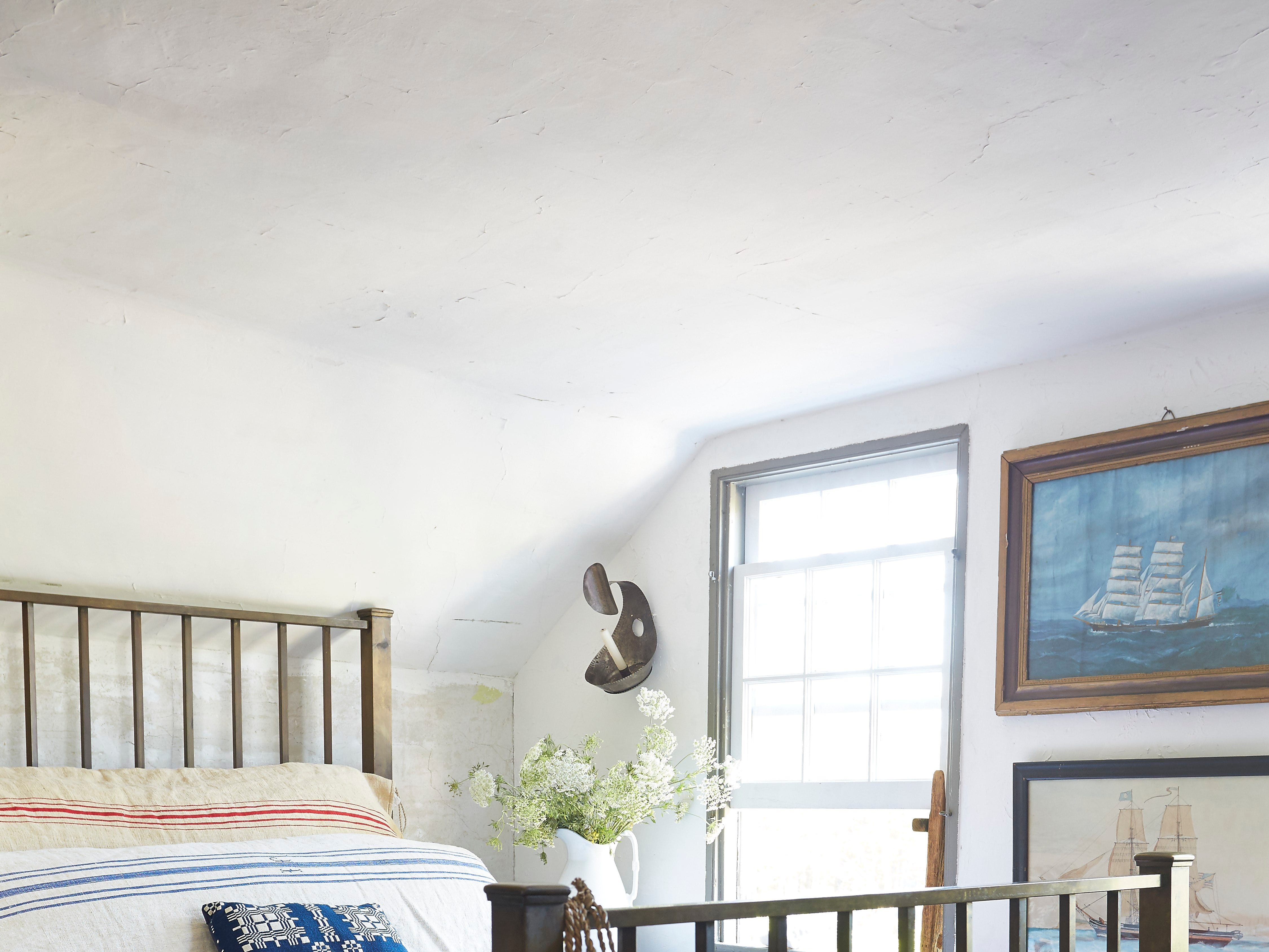 Whitewashed plaster walls make Nora's guest room, one of two tiny upstairs bedrooms dating back to the tavern's stagecoach days, both cheerful and inviting.
