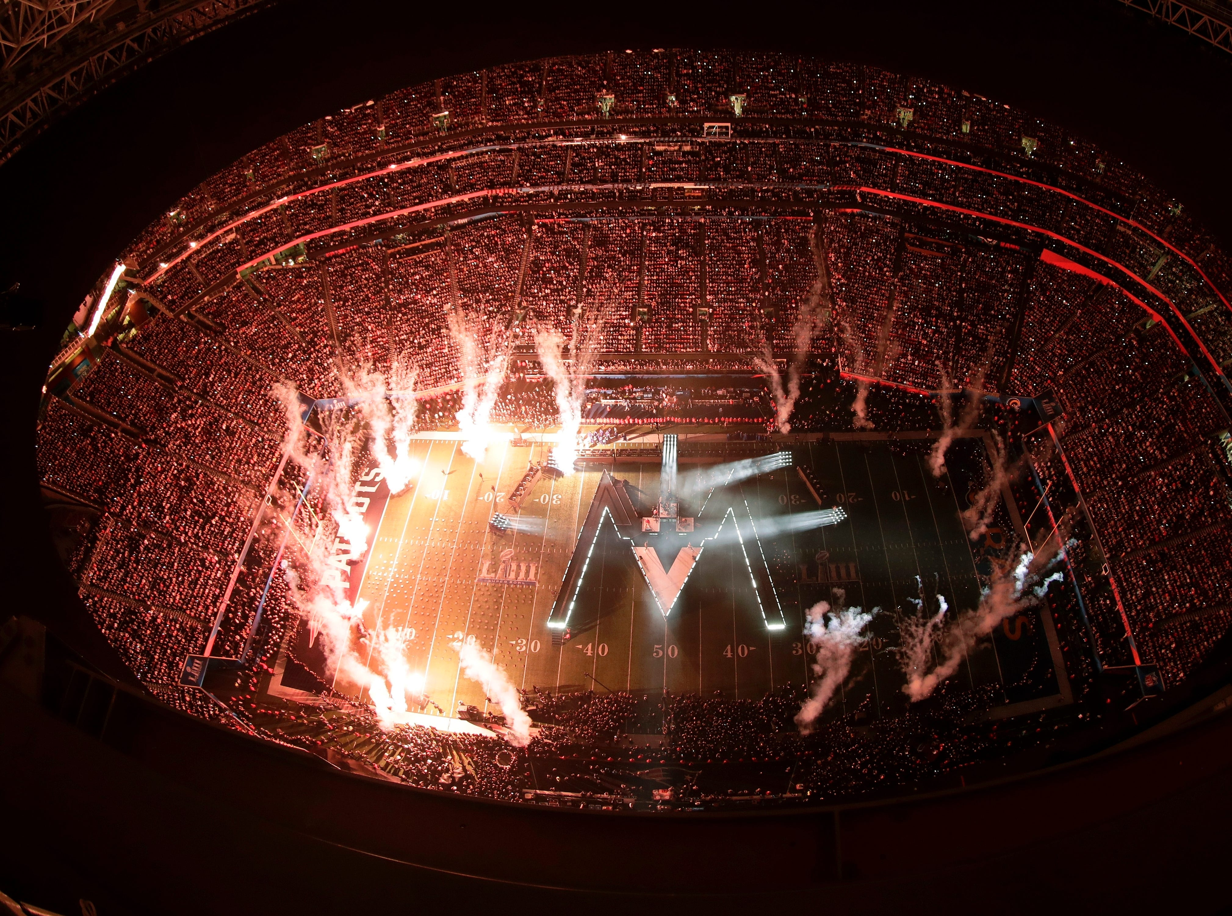 Fireworks illuminate the stage during halftime.