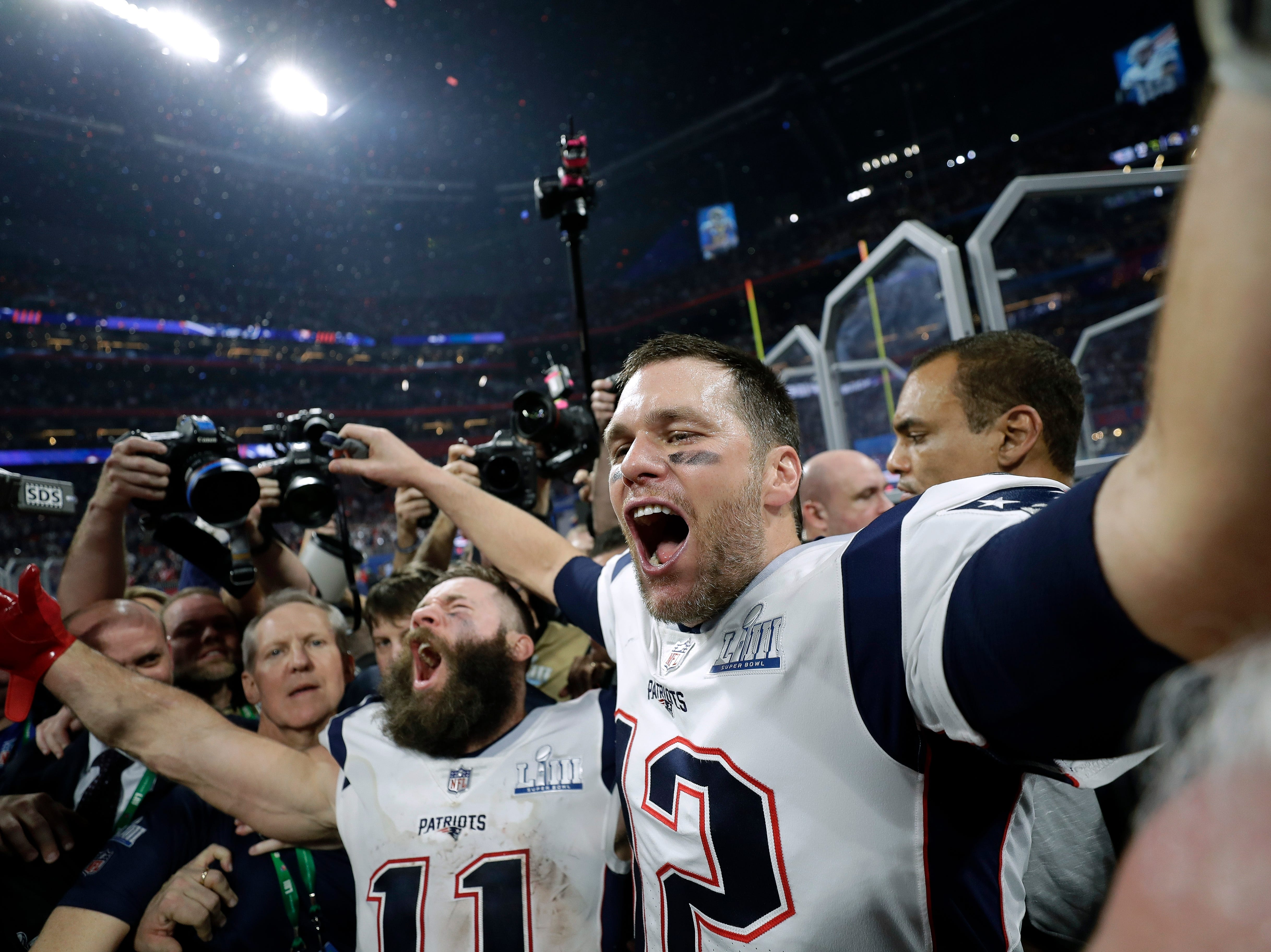New England Patriots' Julian Edelman, left, and Tom Brady celebrate after the game.