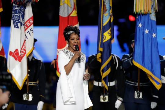 Gladys Knight sings the national anthem before the Super Bowl  between the Los Angeles Rams and the New England Patriots.